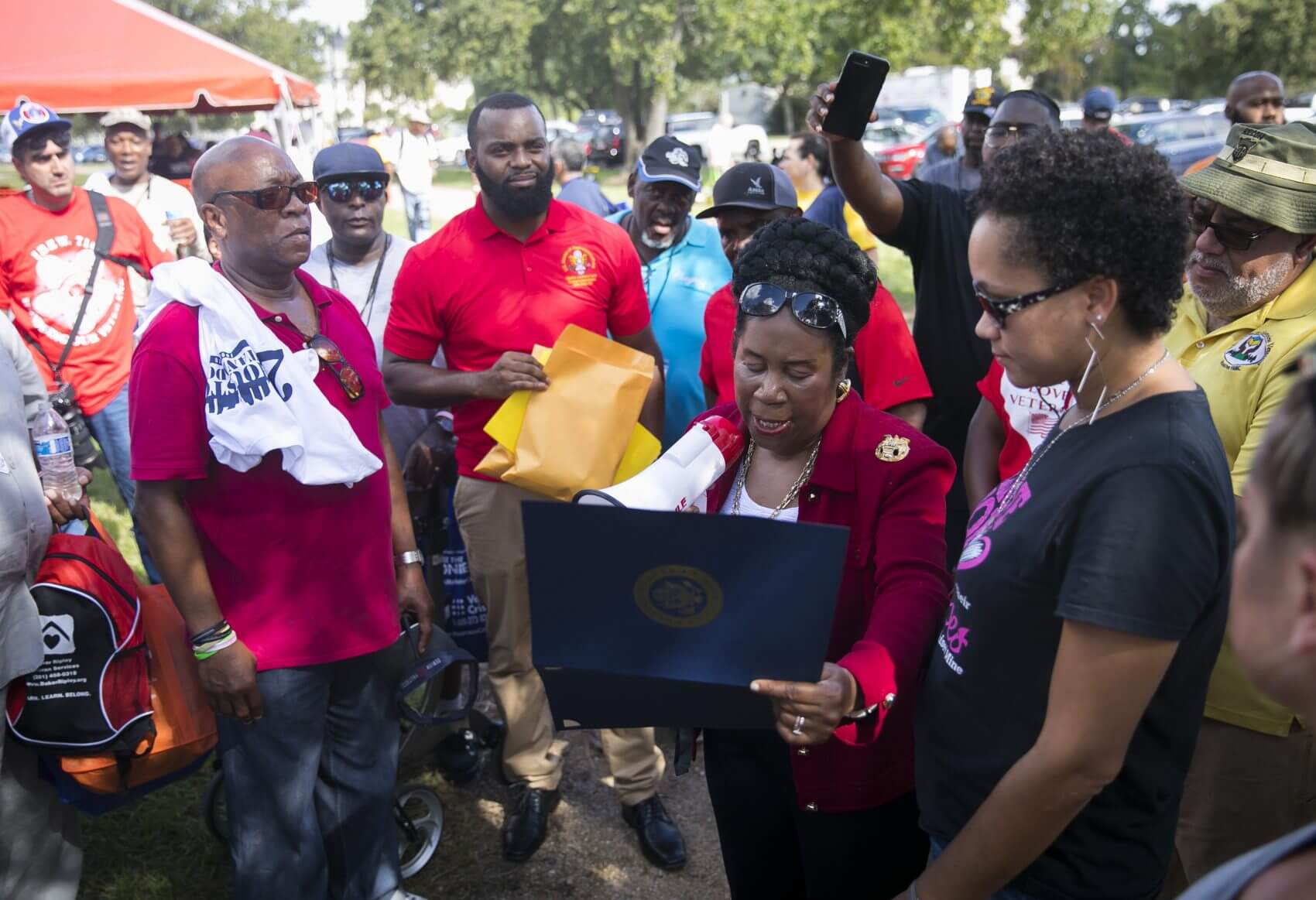 Congresswoman Sheila Jackson Lee reads a proclamation before pinning Vietnam veterans for their service during Houston Stand Down on Friday, Oct. 5, 2018. (Photo: Annie Mulligan)