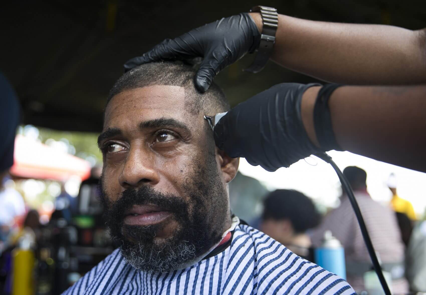 Tyler Mitchell receives a haircut during  Houston Stand Down. Mitchell served with the U. S. Army in Germany when the Berlin wall was torn down.  (Photo: Annie Mulligan)
