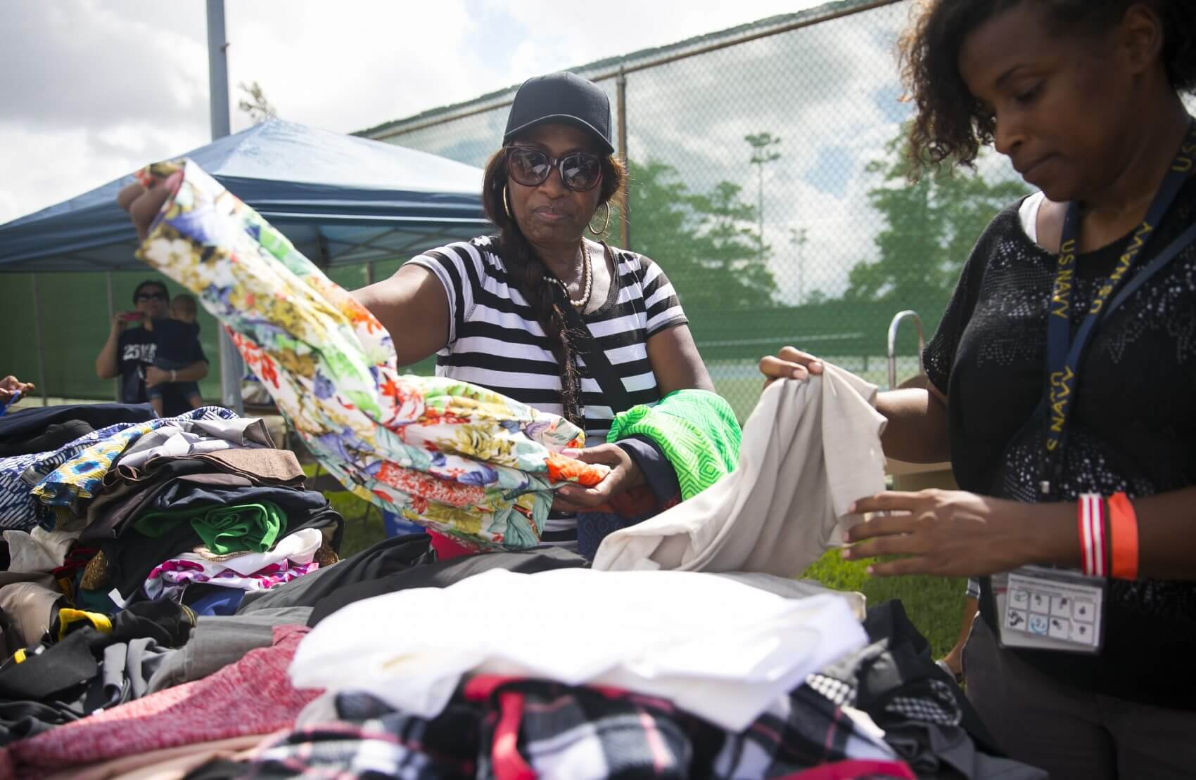 Lauren Williams, left, selects clothing from a donations table at Houston Stand Down on Oct. 5, 2018 in MacGregor Park. (Photo: Annie Mulligan)