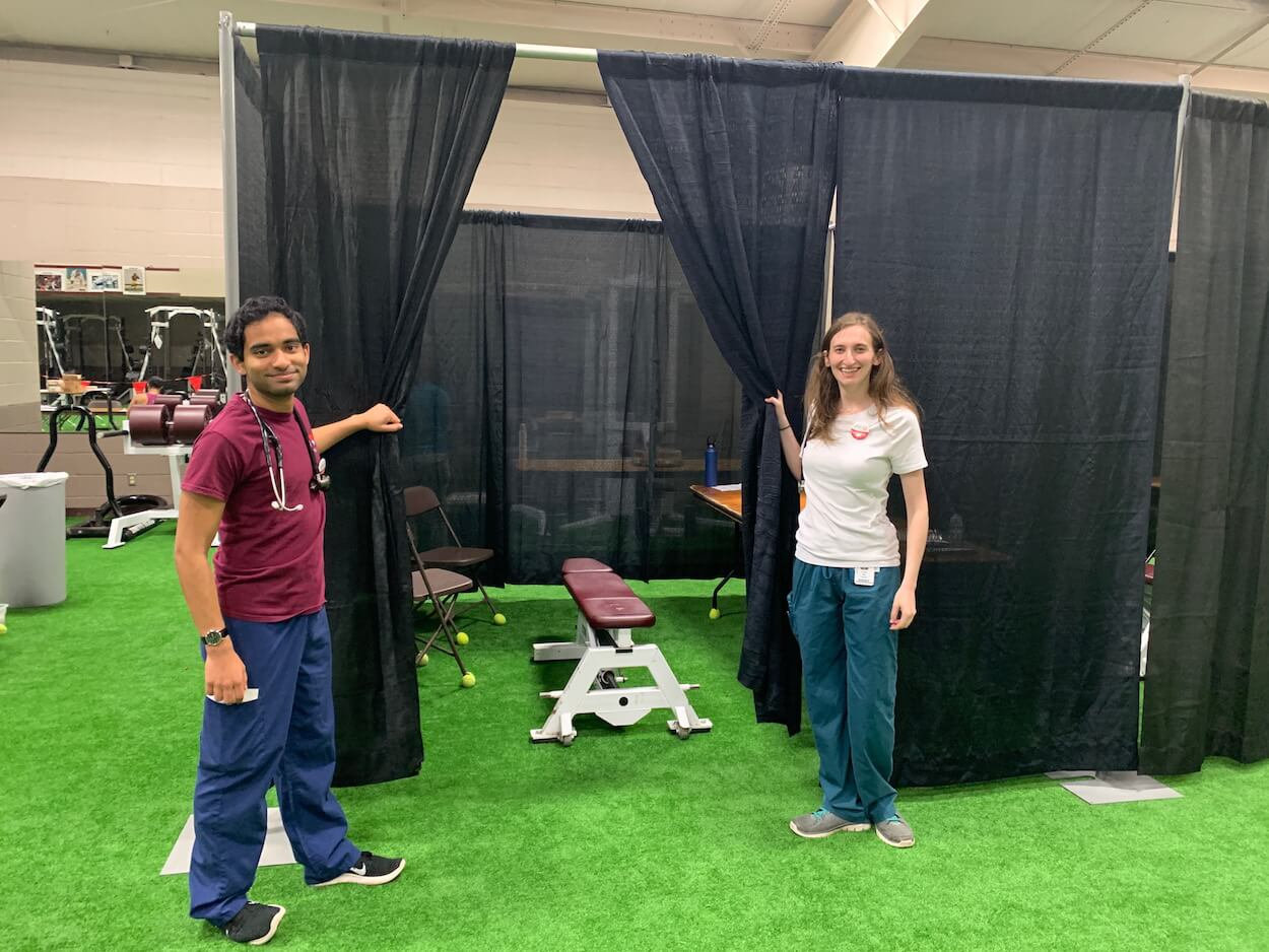 Alex Alexander and Lindsey Alter, second-year medical students at Baylor College of Medicine, prepare makeshift patient rooms to provide physicals.