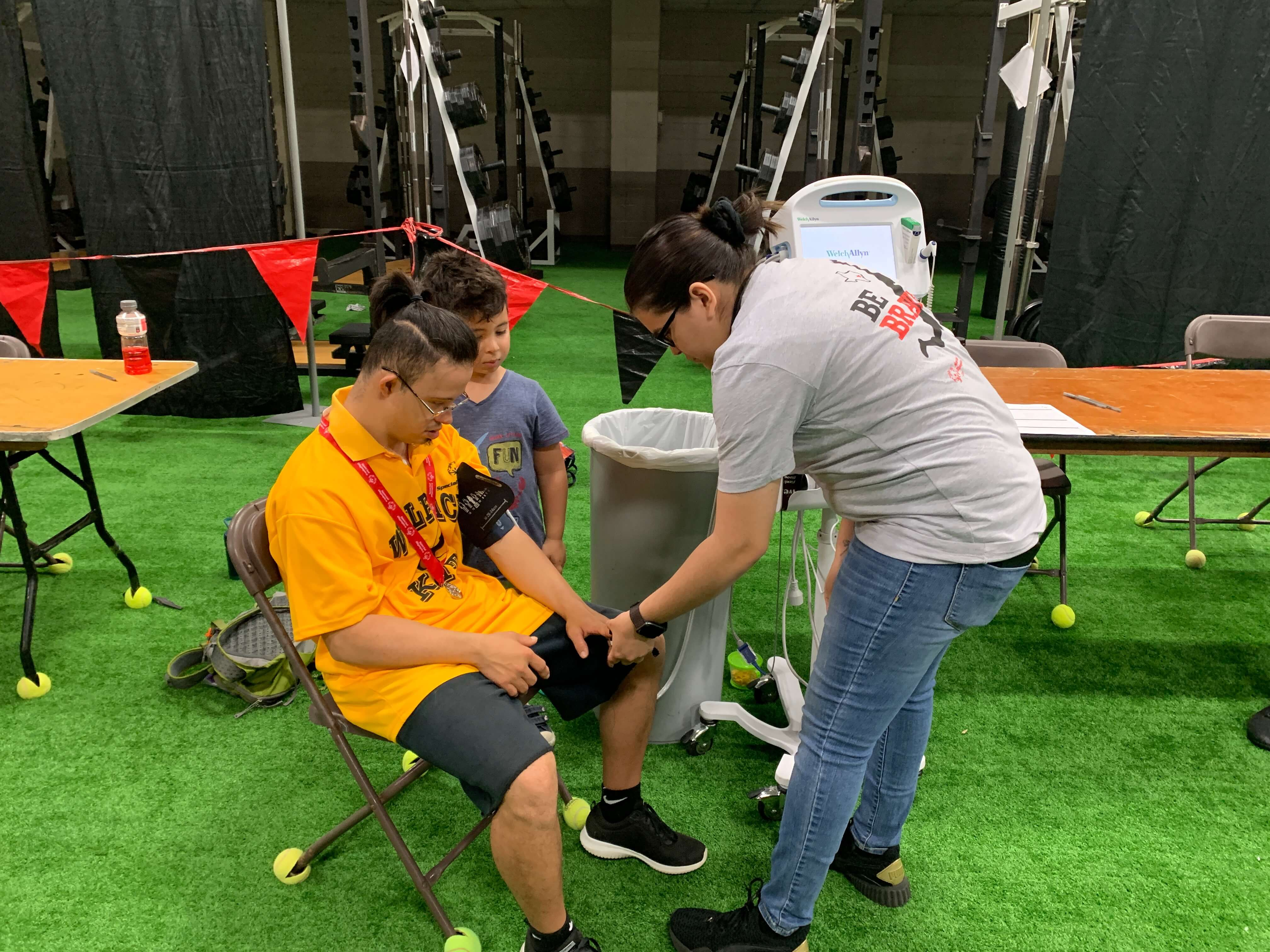 Ozi Agirbas, a 26-year-old athlete, gets his blood pressure checked in the Special Olympics MedFest tent.
