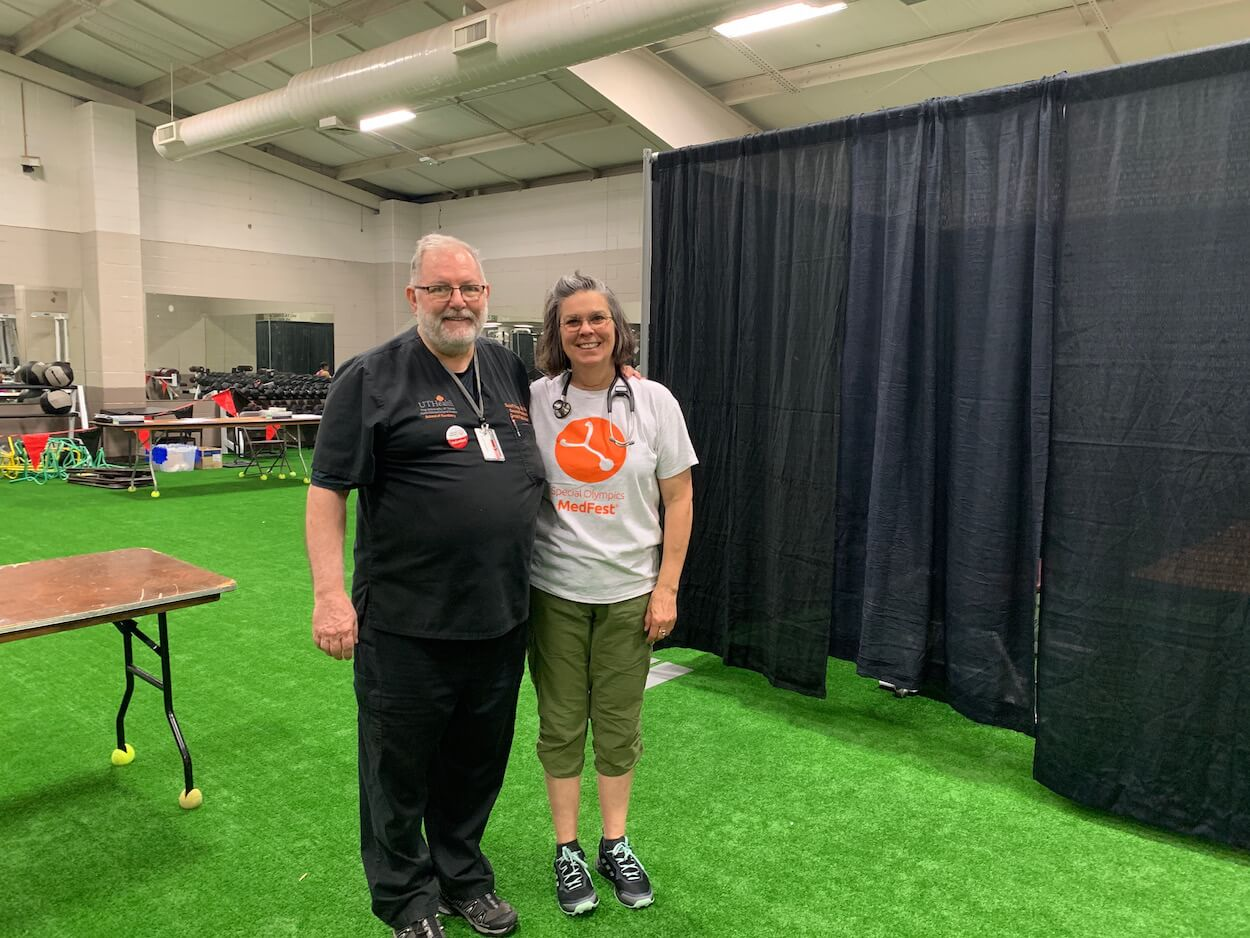David Fray, D.D.S., left, and Cynthia Peacock, M.D., director of the Baylor Transition Clinic, serve as medical directors of MedFest and Healthy Smiles for Special Olympics athletes.