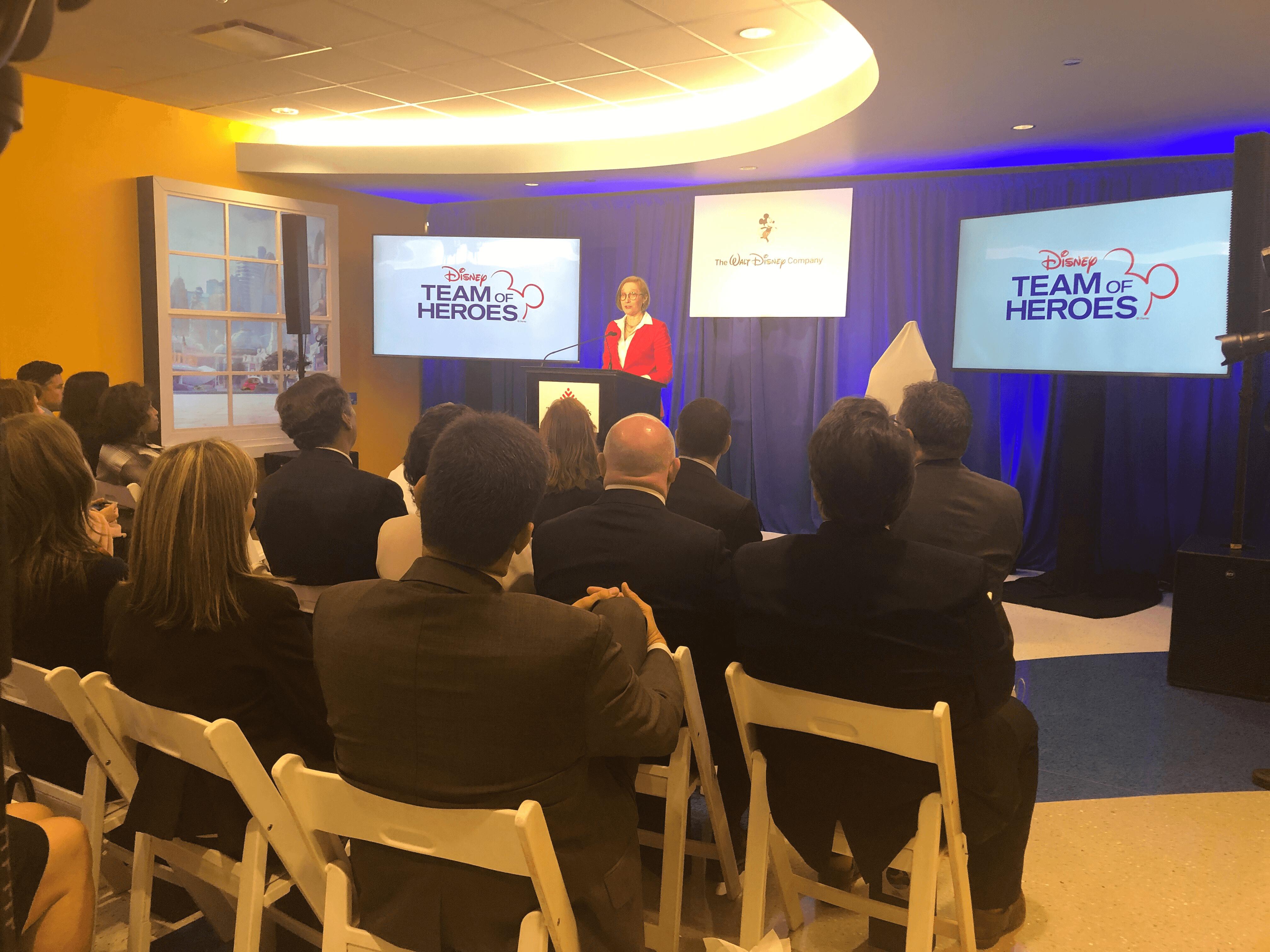 Elissa Margolis, senior vice president of enterprise social responsibility for The Walt Disney Co., speaks during the launch of the Disney Team of Heroes.
