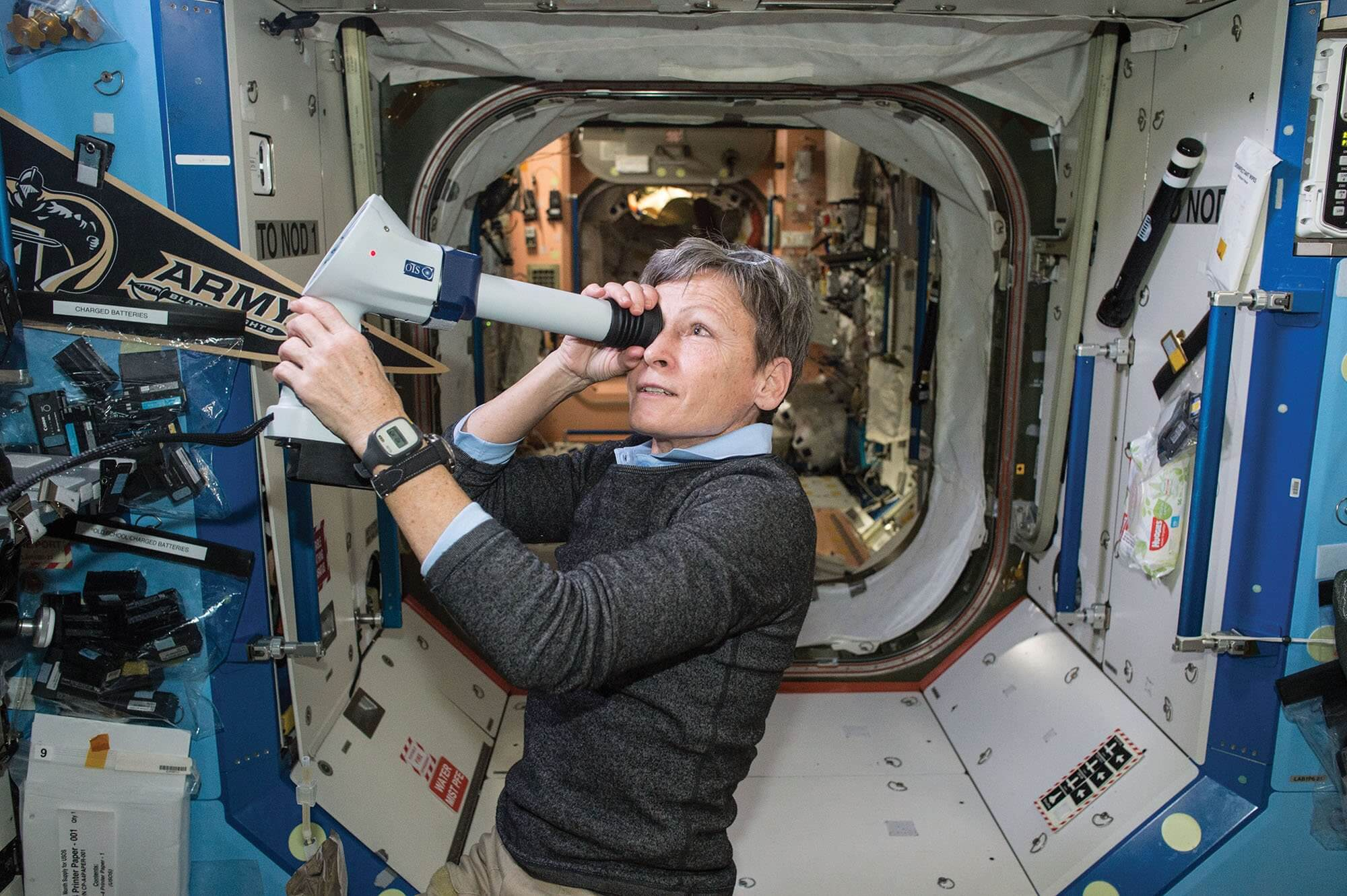 NASA astronaut Peggy Whitson, Ph.D., collects Fundoscope images of the back of the eye during a routine check into astronaut eyesight. Crew members' bodies change in a variety of ways during space flight, and some experience impaired vision. Credit: NASA