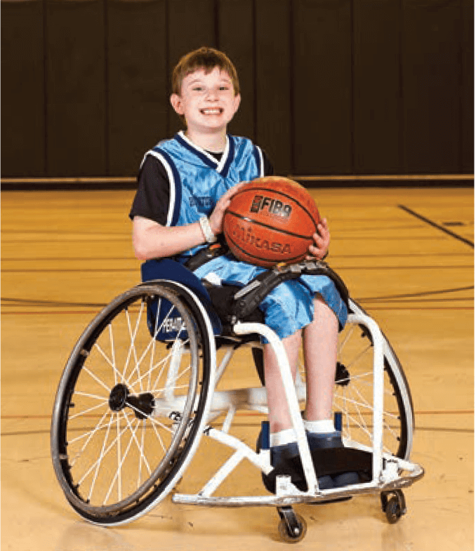 Founded in 1977, TIRR Memorial Hermann Hotwheels is a competitive traveling junior wheelchair basketball team, comprised of elementary, middle and high schools students age eight to 18. Peter, left, and Aaron Berry, right, are both proud members of the team. (Credit: TIRR Memorial Hermann)