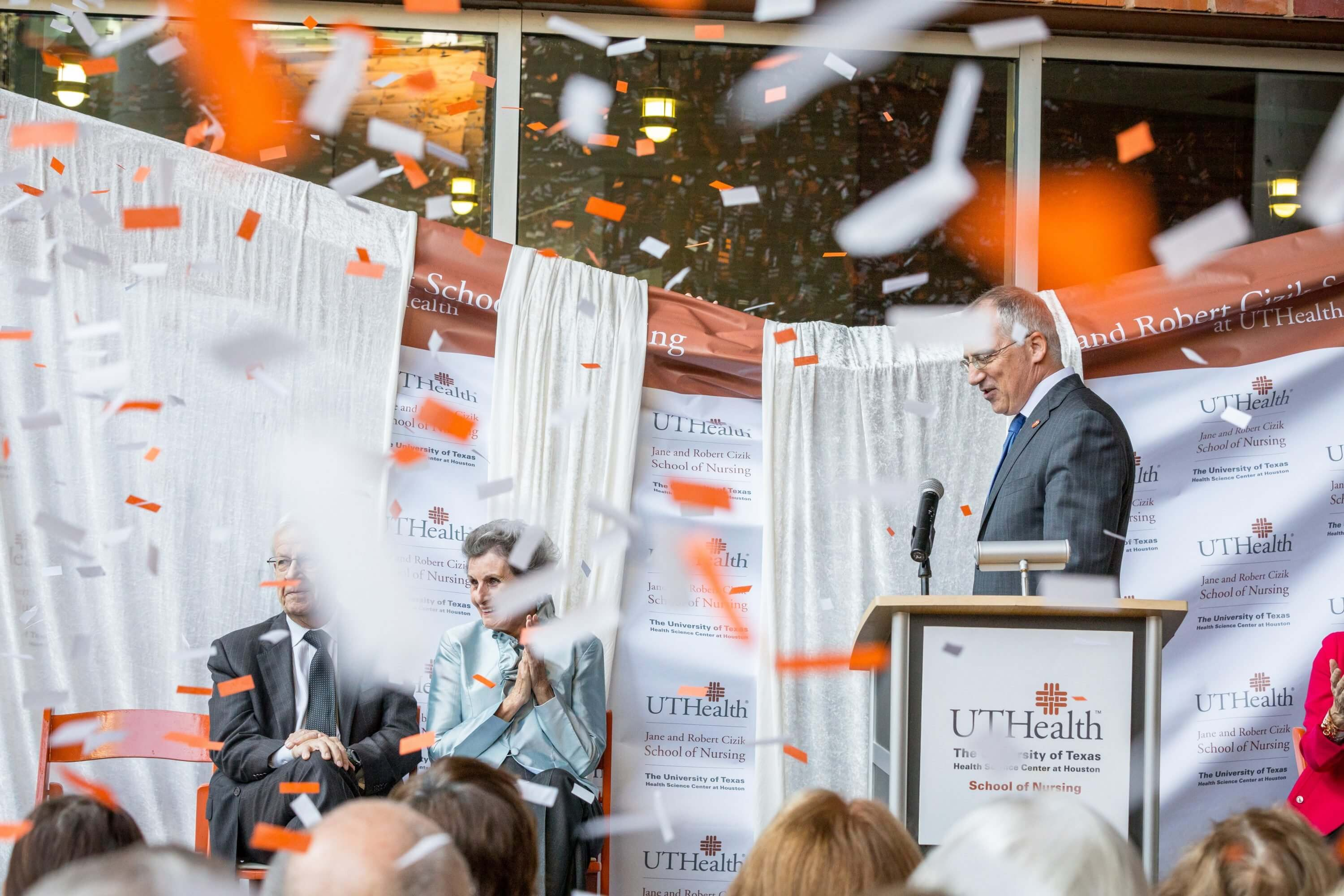 Robert and Jane Cizik, onstage with UTHealth  President Giuseppe Colasurdo, M.D., are saluted with confetti at the event. Photo by J. Daniel Escareño/UTHealth.