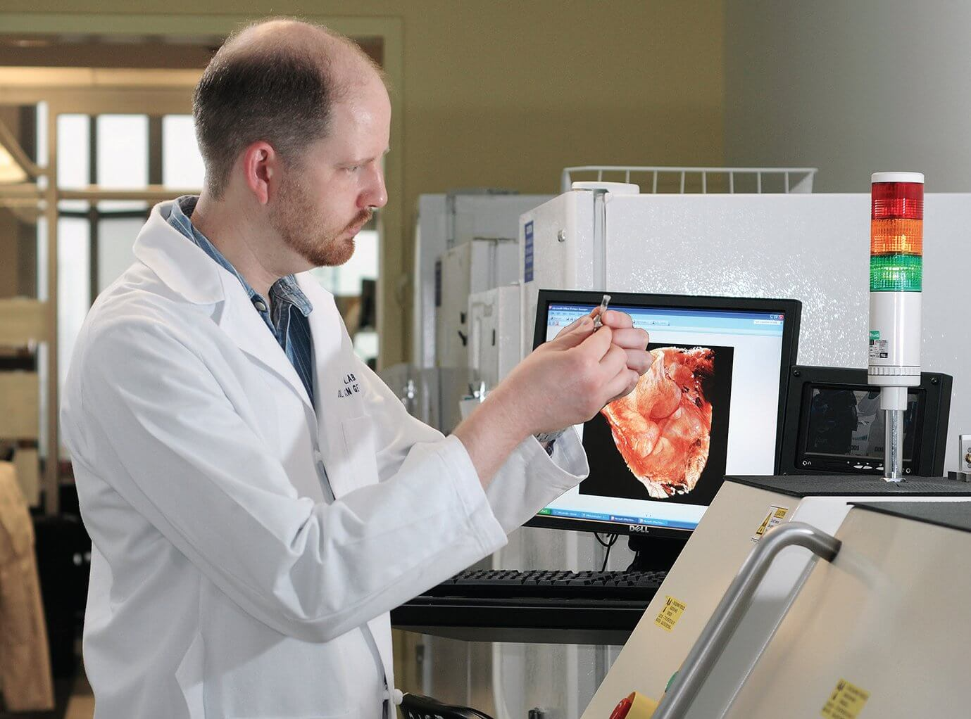 Brian Dawson, MicroCT Core specialist, operates the Xradia MicroXCT imaging system, which allows Lawrence BDPT researchers to visualize bone and cartilage at a resolution never before achieved. (Credit: The Rolanette and Berdon Lawrence Bone Disease Program of Texas)