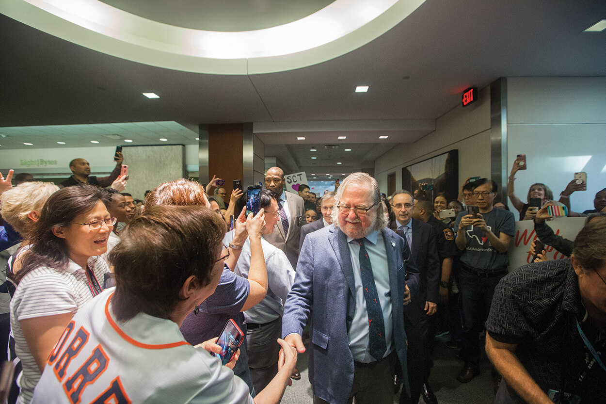 A crowd congratulates James Allison, Ph.D., at The University of Texas MD Anderson Cancer Center in October 2018.