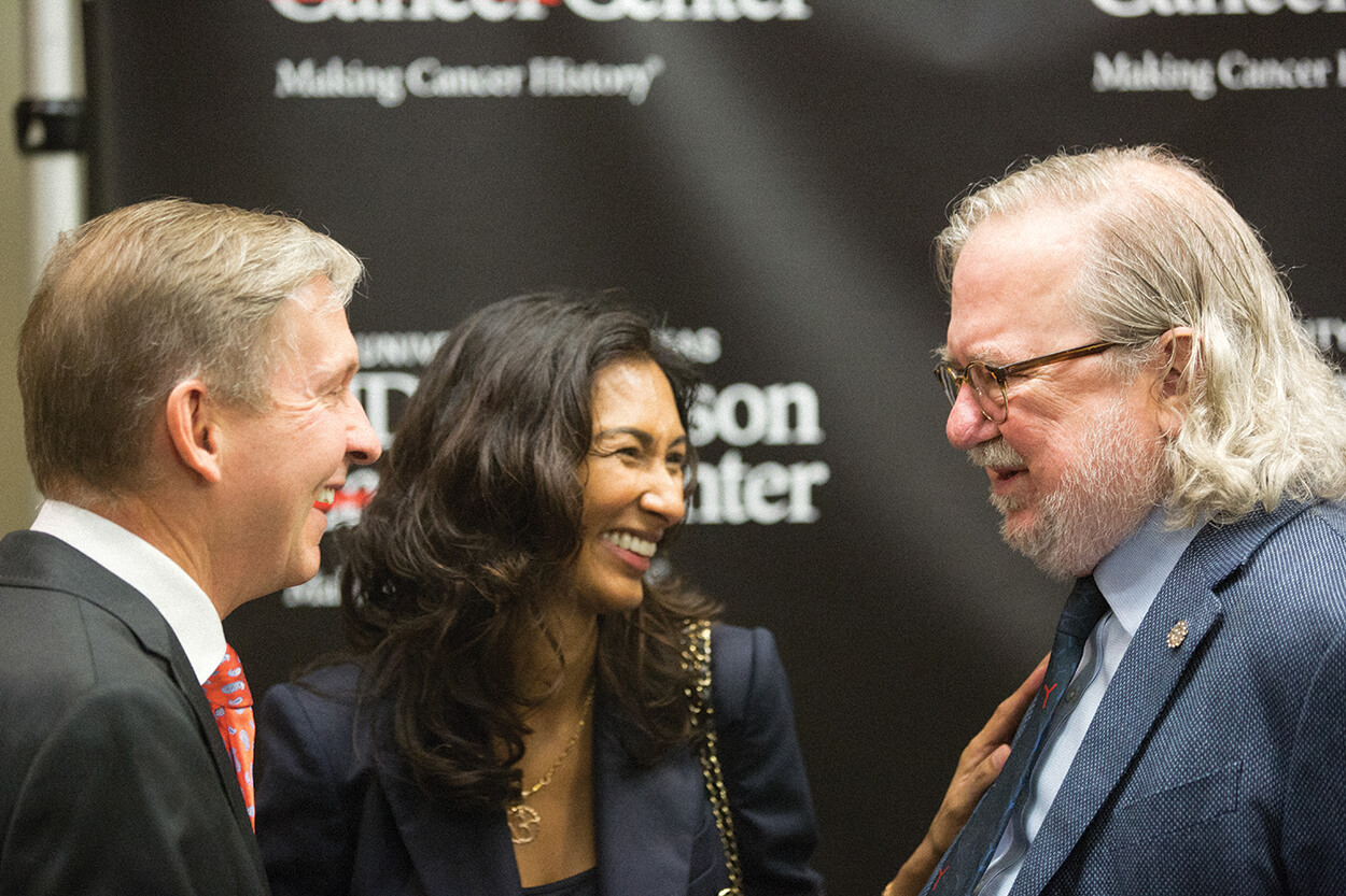 MD Anderson president Peter Pisters, M.D., left, speaks with Allison and his wife, Padmanee Sharma, M.D., Ph.D., professor in the department of genitourinary medical oncology at MD Anderson, during a press conference In October 2018.
