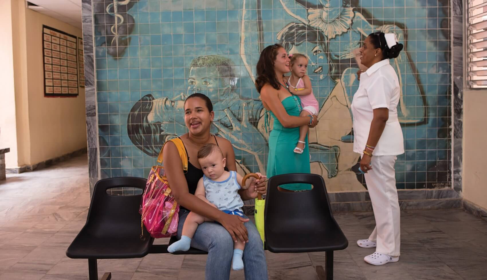 Patients in the waiting room of a Cuban health clinic. Credit: © Magnum Photographer Cristina Garcia Rodero