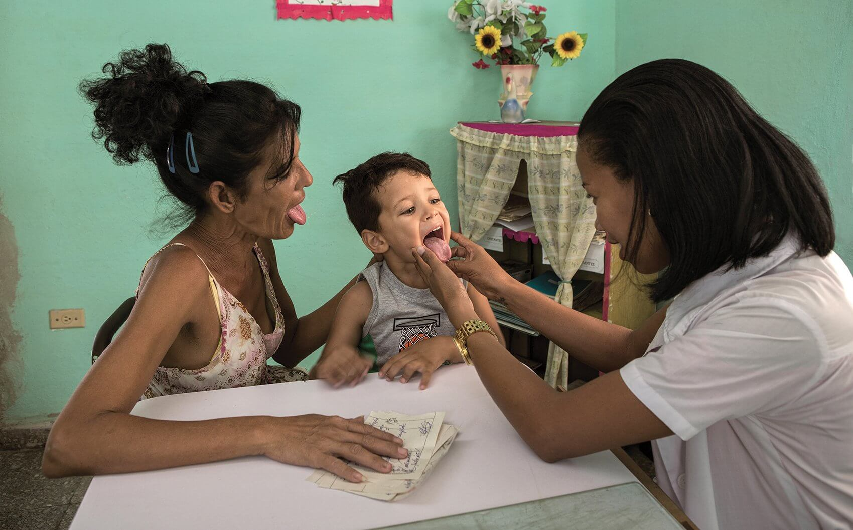A young boy is examined in a Cuban health clinic. Credit: © Magnum Photographer Cristina Garcia Rodero