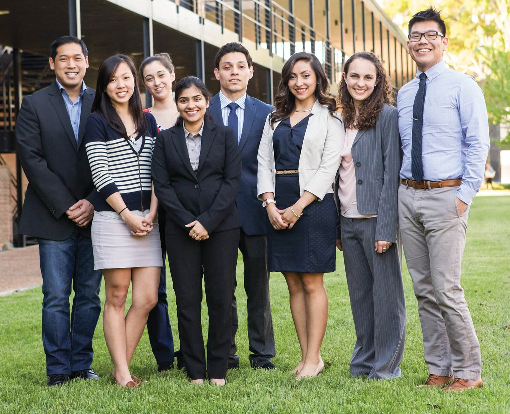 The inaugural Master in Clinical Translation Management class, from left to right: Richard Le, Rosemary Tran, Maria Babu, Heather Vasquez, Homer Quintana, Perla Rodriguez, Amy Ewbank and Dr. Edward Nam.