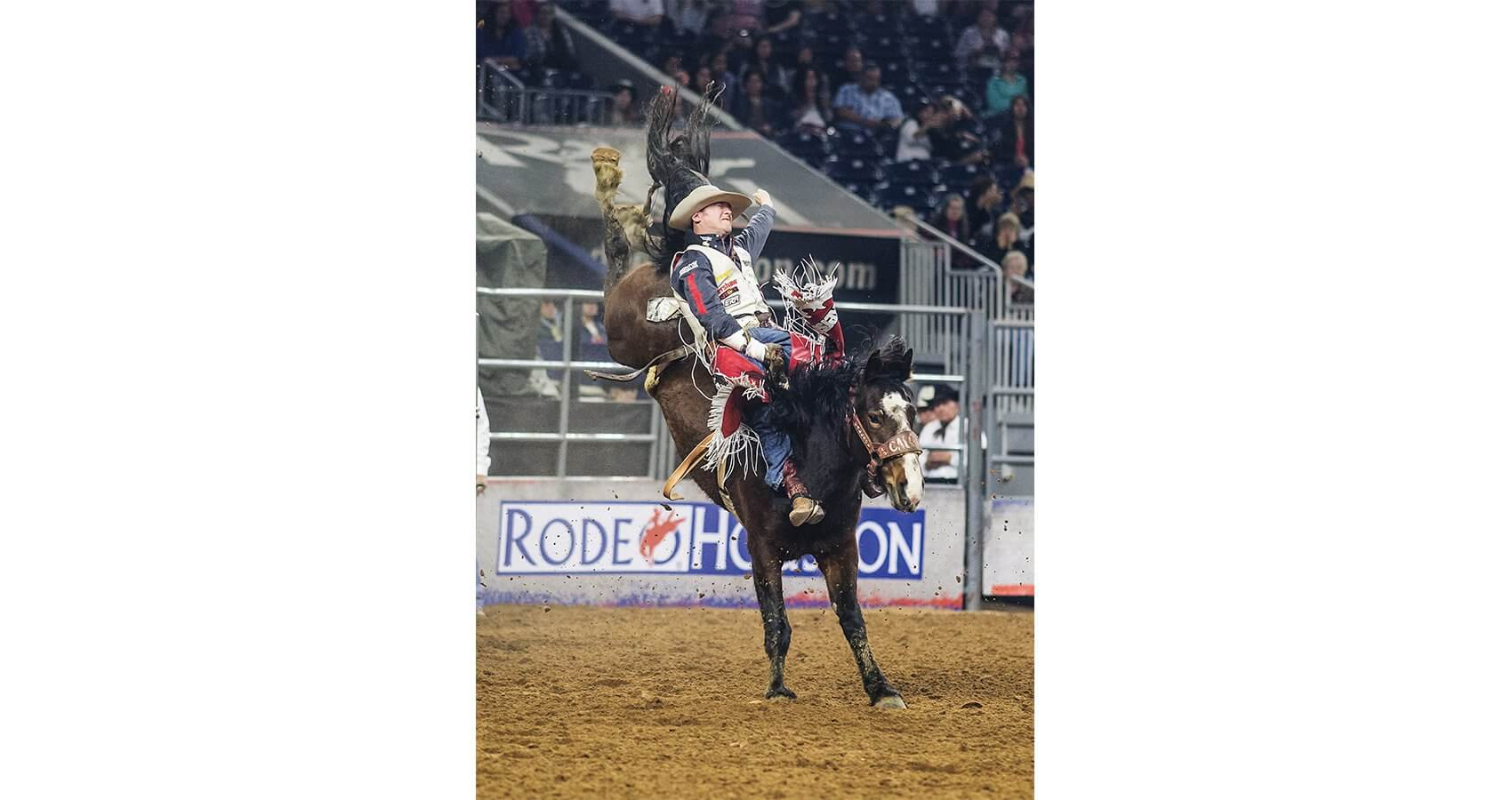 Bareback rider Steven Peebles holds on tight to bronco Twin Cherry during RodeoHouston's BP Super Series.