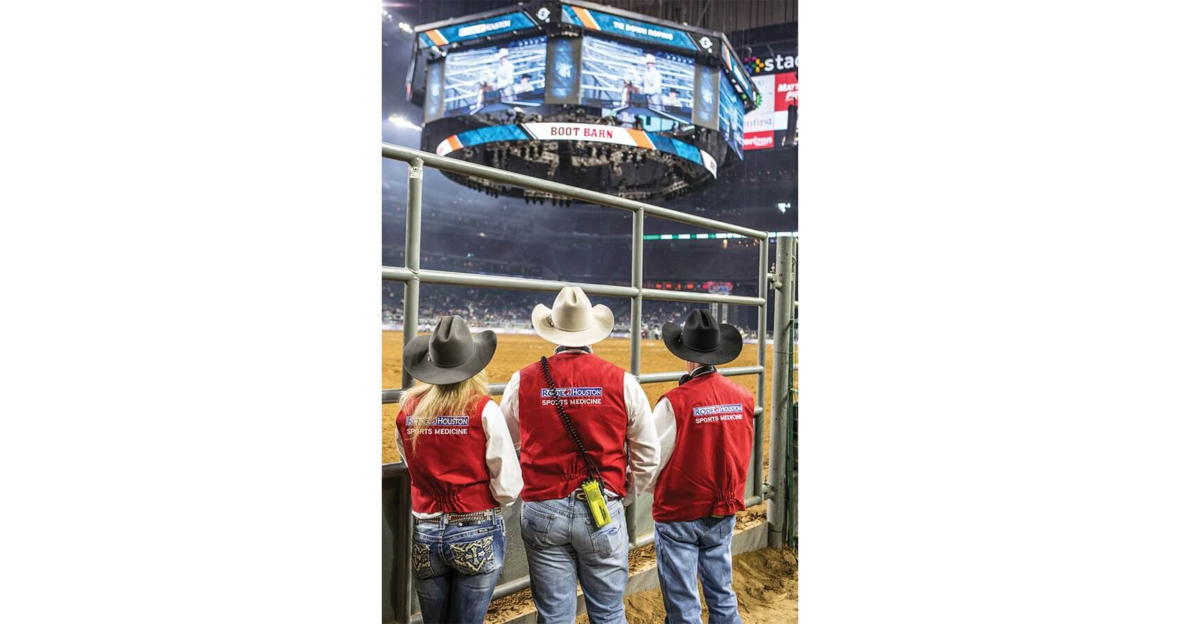 RodeoHouston sports medicine staff watch the competition from the sidelines, always ready to assist the cowboys.