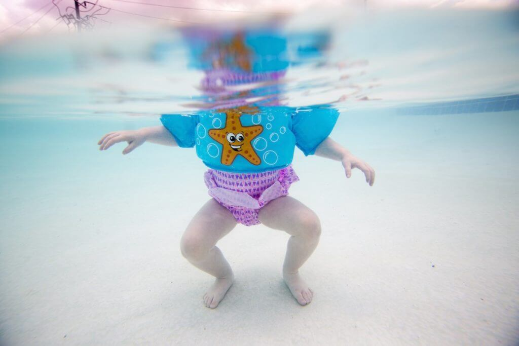 A child plays in a swimming pool.