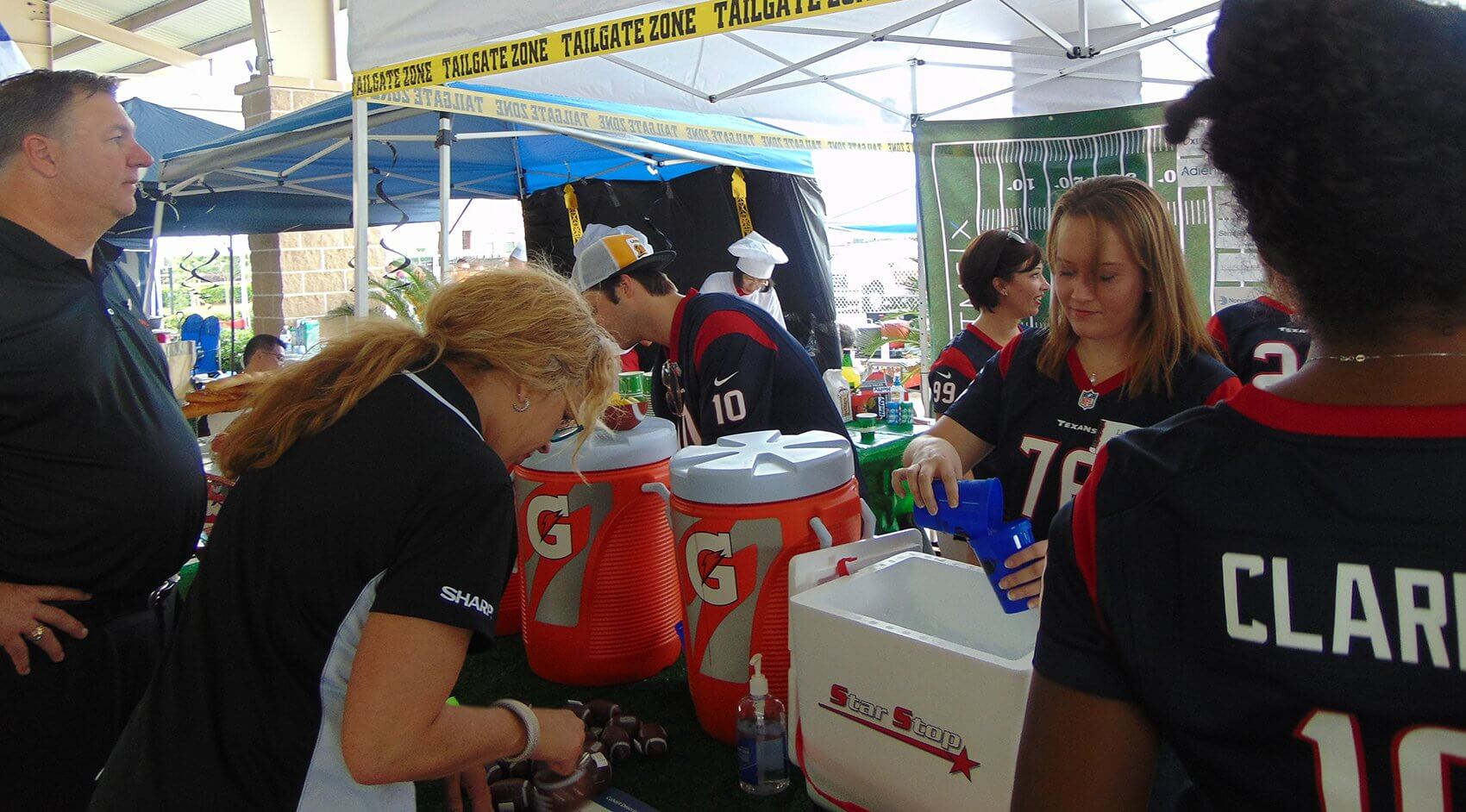 "TMCx serving up drinks in the ""Tailgate Zone."""