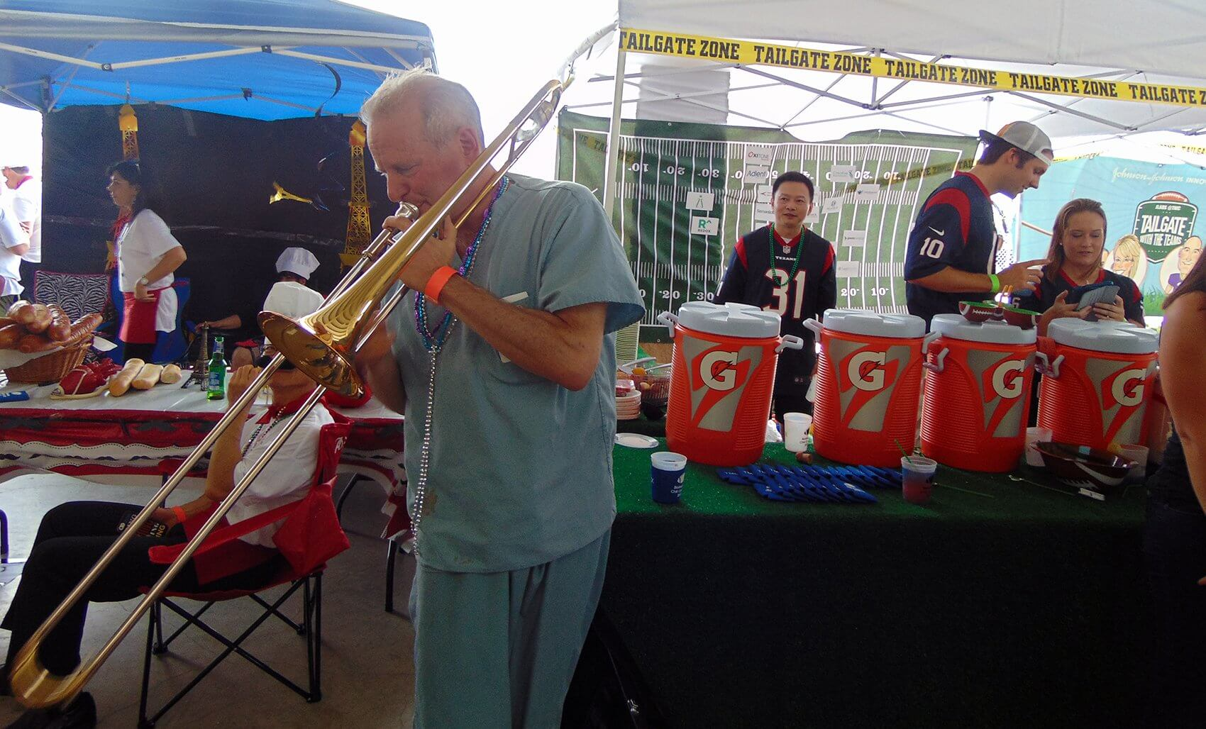 Cohn treats cook-off attendees to a trombone performance.