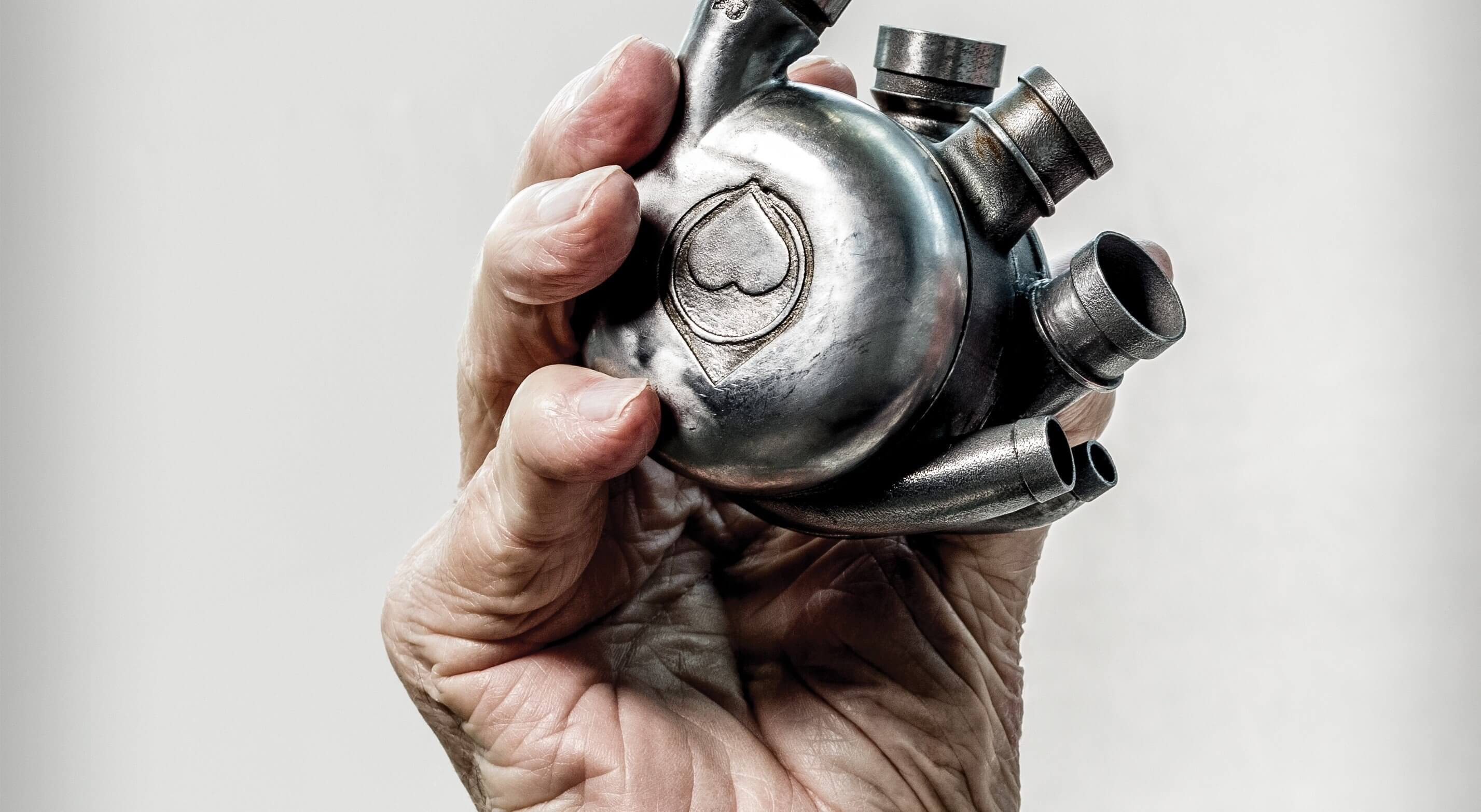 Cooley holds a Bivacor total artificial heart. Research on the device is ongoing at the Texas Heart Institute.