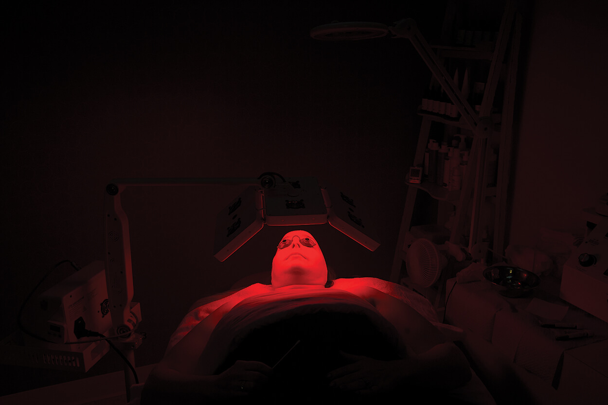 At Baylor College of Medicine's Aesthetics Studio, Sabrea Munz is treated under an LED light after a vampire facial.