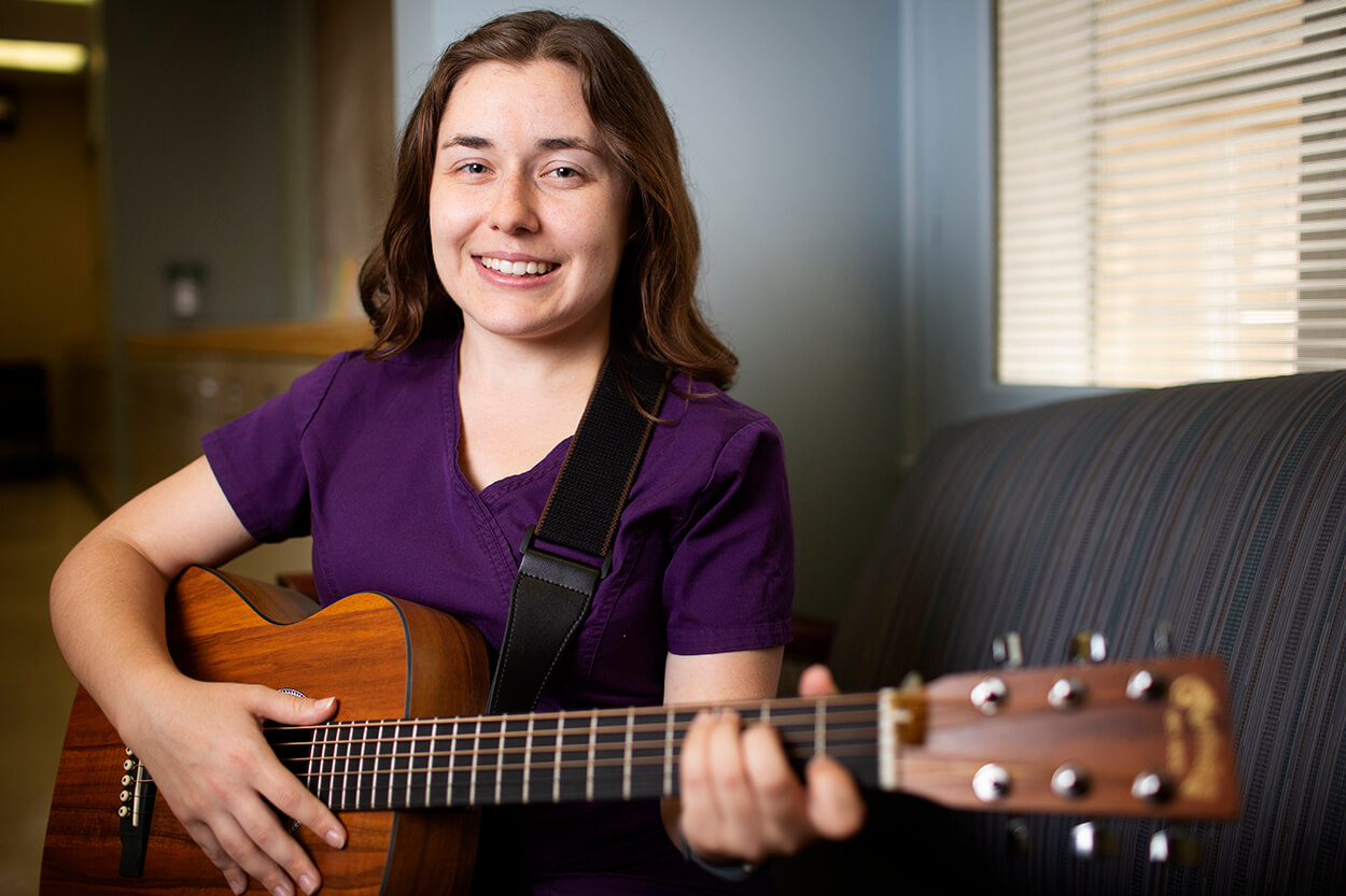 Music therapist Audrey Zybura plays the guitar at Houston Methodist Hospital.