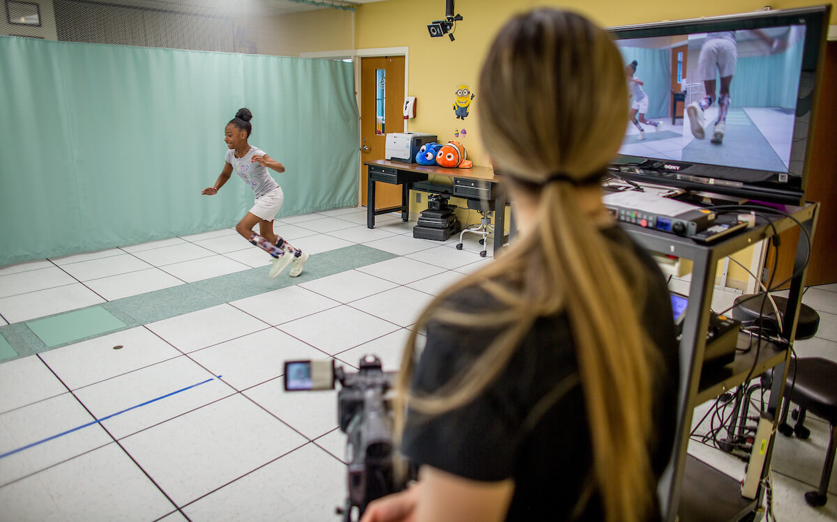Madilyn Jenkins, 9½, runs on the force plates during a post-operative exam in the motion analysis center at Shriners Houston on May 6, 2019. (Photo by Nick de la Torre)
