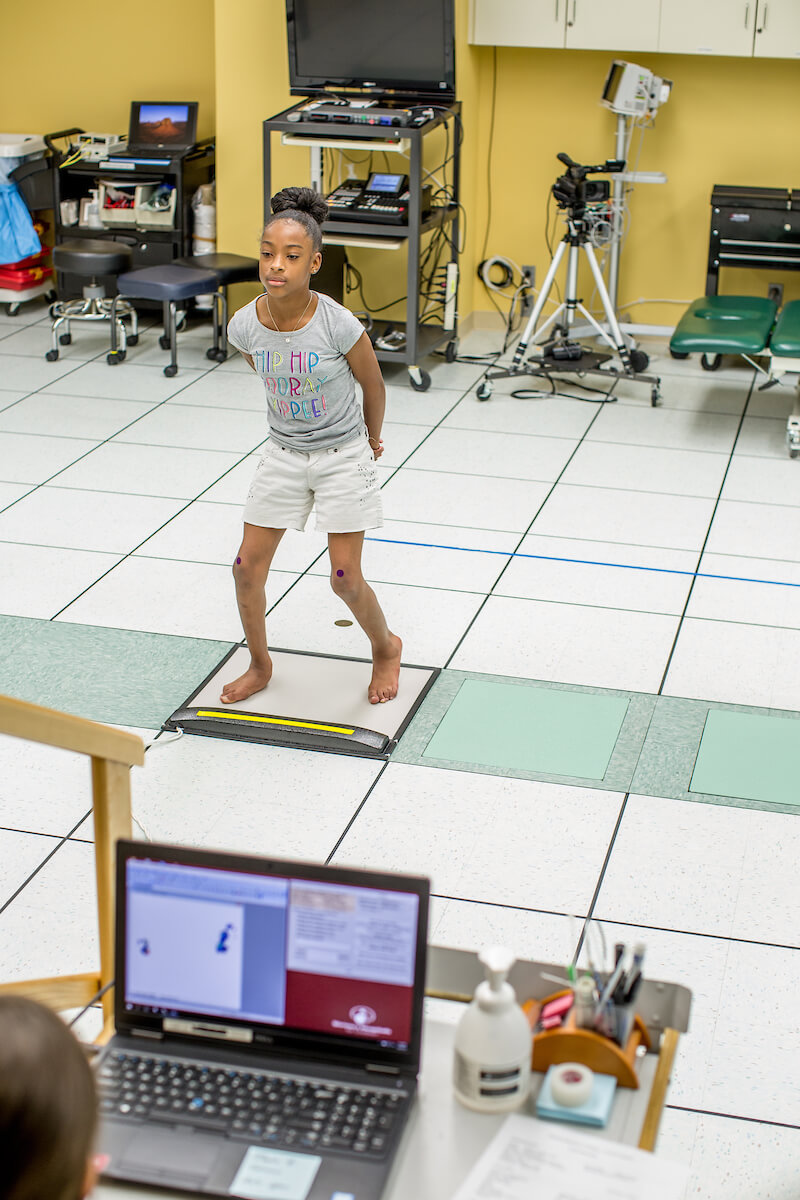 Madilyn Jenkins, 9½, stands on a foot pressure analysis mat during a post-operative exam in the motion analysis center at Shriners Houston on May 6, 2019. (Photo by Nick de la Torre)
