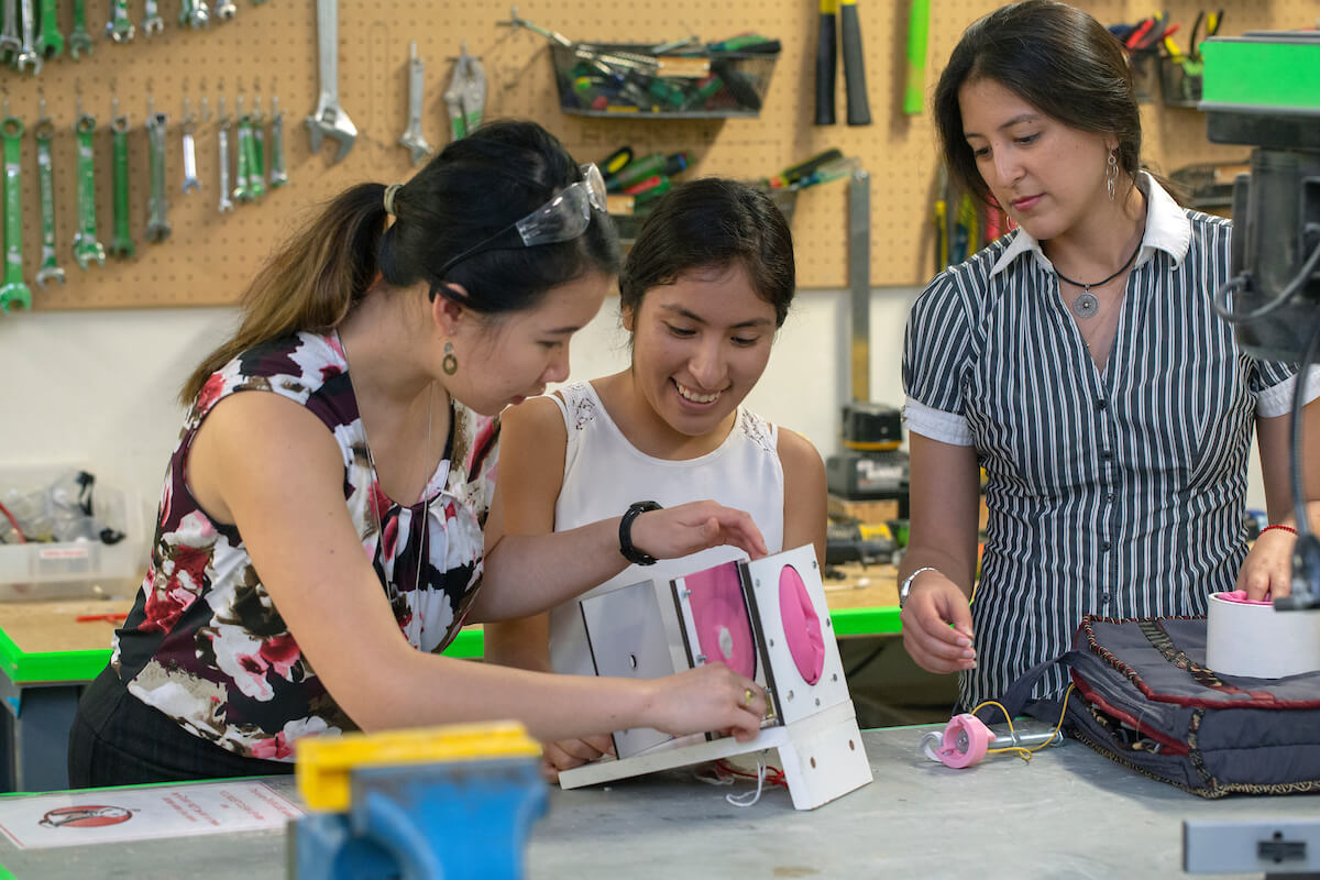 Christine Luk, a master's degree student in bioengineering at Rice University; Karen Vasquez Ruiz, who graduated from Rice this spring with a degree in bioengineering; and Sonia Gomez Parra, who earned her Ph.D. in bioengineering from Rice this spring, examine a cervix model at the OEDK.