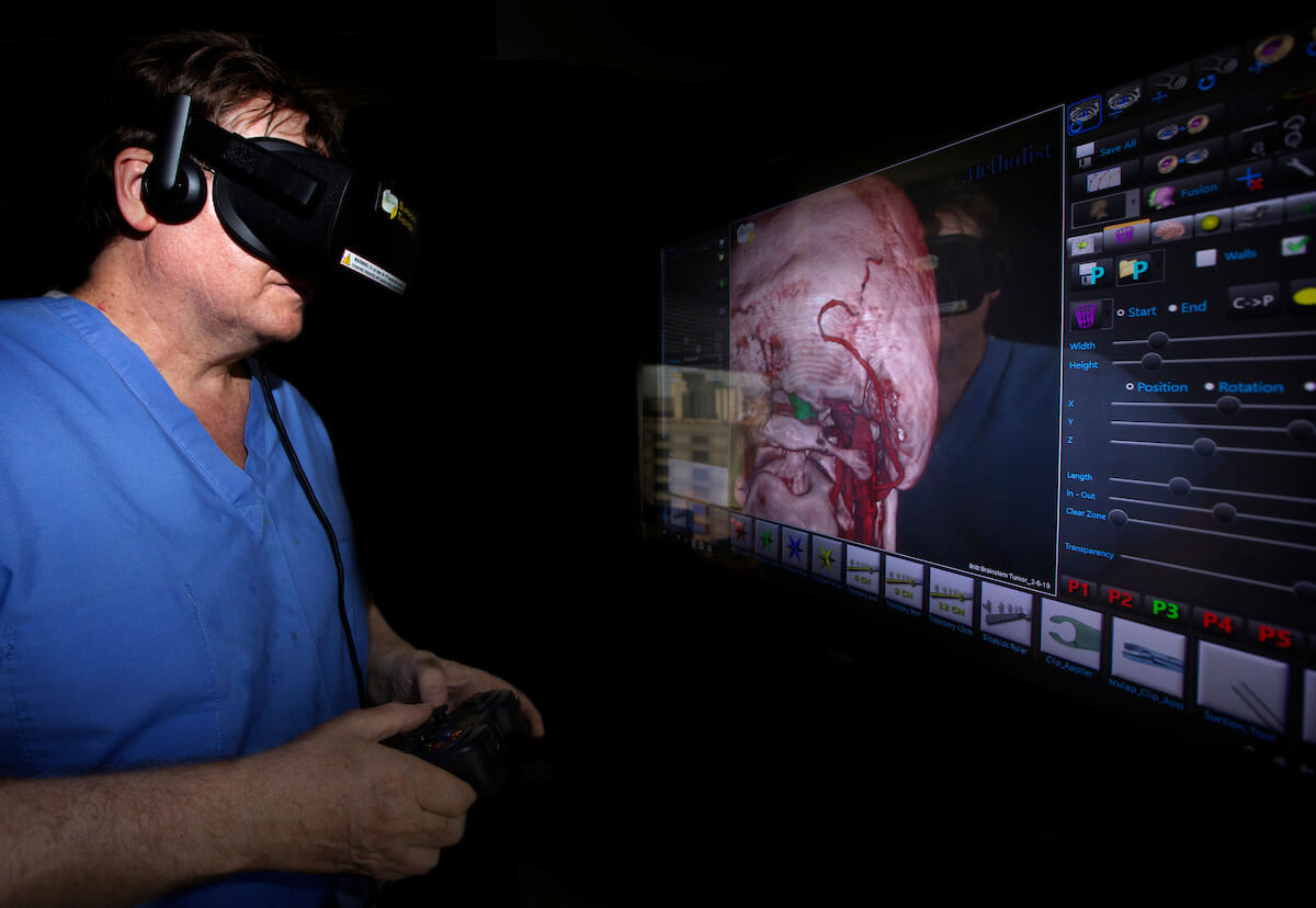 Using a representation of a patient's brain, Houston Methodist neurosurgeon Gavin Britz, MBBCh, MBA, MPH, demonstrates how he navigates the brain using 3D wraparound goggles and the Surgical Theater system.