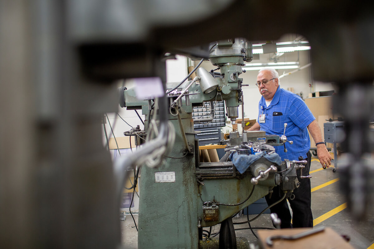Juan Fernandez, lead machinist at Houston Methodist Hospital, builds and modifies devices in the machine shop located in a Houston Methodist parking garage.