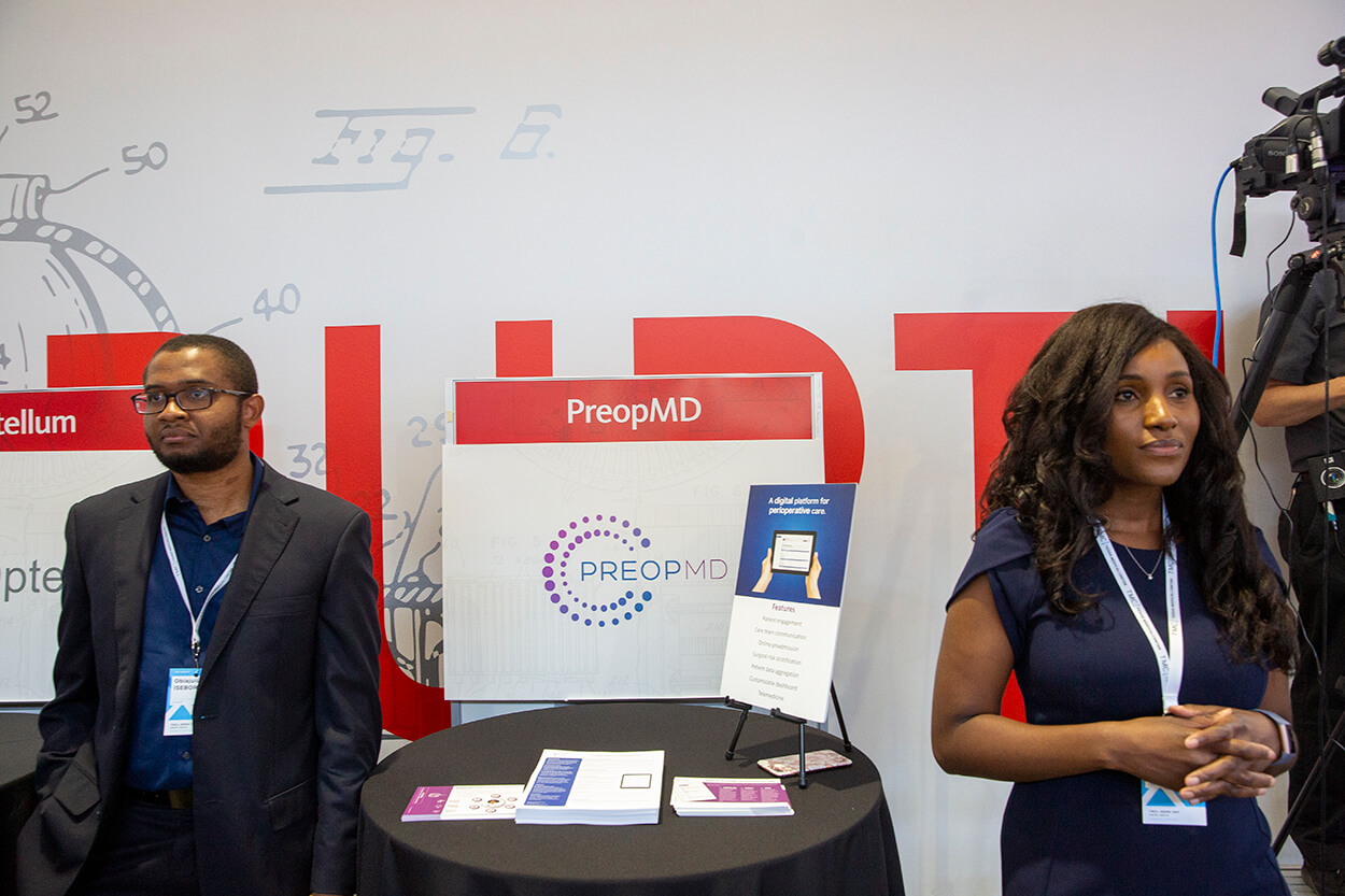 PreOp MD co-founder Obiajulu Isebor, Ph.D., and the preoperative clearance platform's founder and CEO, Houston anesthesiologist Christiana Obi, O.D., wait to take questions at their booth during TMCx Demo Day on June 6, 2019. (Photo by Cody Duty)