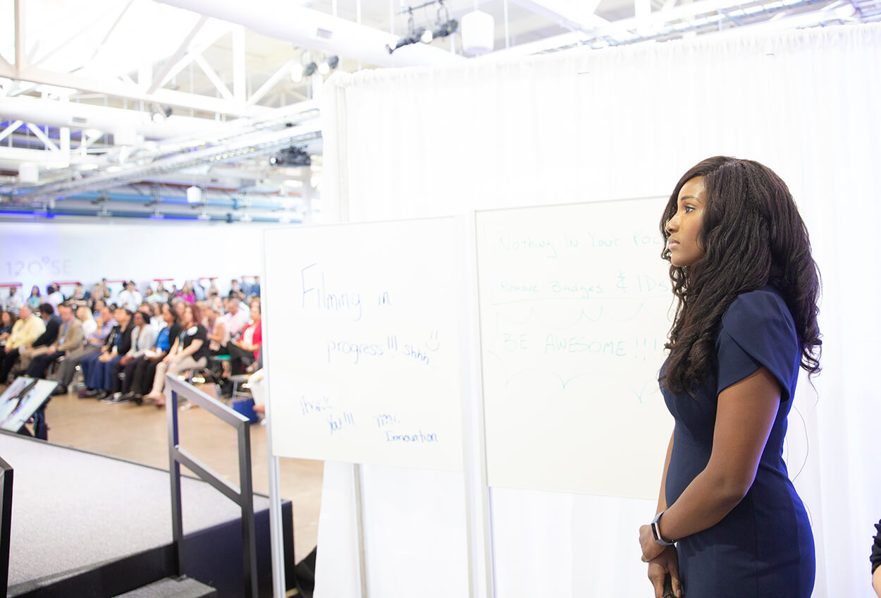 Houston anesthesiologist Christiana Obi, O.D., prepares to pitch her preoperative clearance platform, PreOp MD, at TMCx Demo Day on June 6, 2019. (Photo by Cody Duty)