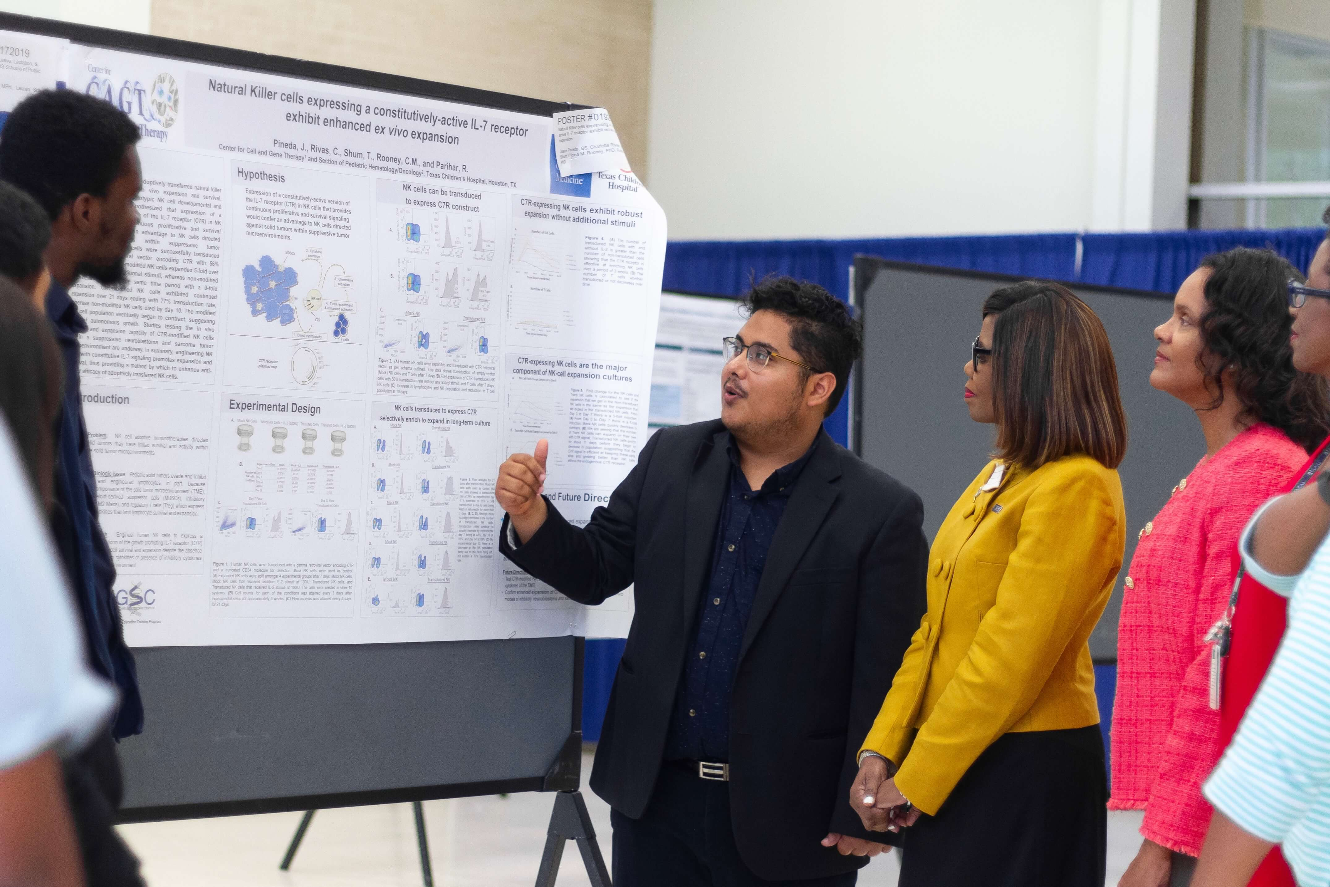 Patrice Harris, M.D., who became the 174th president of the American Medical Association in June 2019, listens to a student explain his poster presentation at Baylor College of Medicine on June 18, 2019. (Photo courtesy of Baylor College of Medicine)