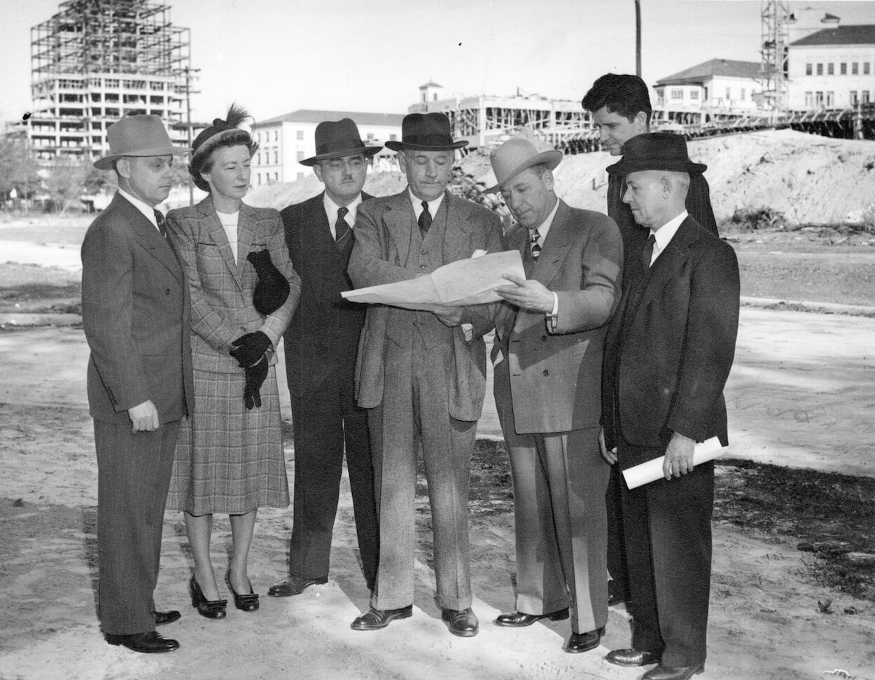 Ernst Bertner, the first president of the Texas Medical Center, center, in 1947 holding plans for the new medical district. (Image courtesy of the McGovern Historical Center, Texas Medical Center Library)