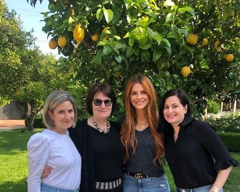 Baylor College of Medicine researcher Melissa Bondy, Ph.D., center left, with television personality and brain tumor survivor Maria Menounos, center right, at her home in Los Angeles.