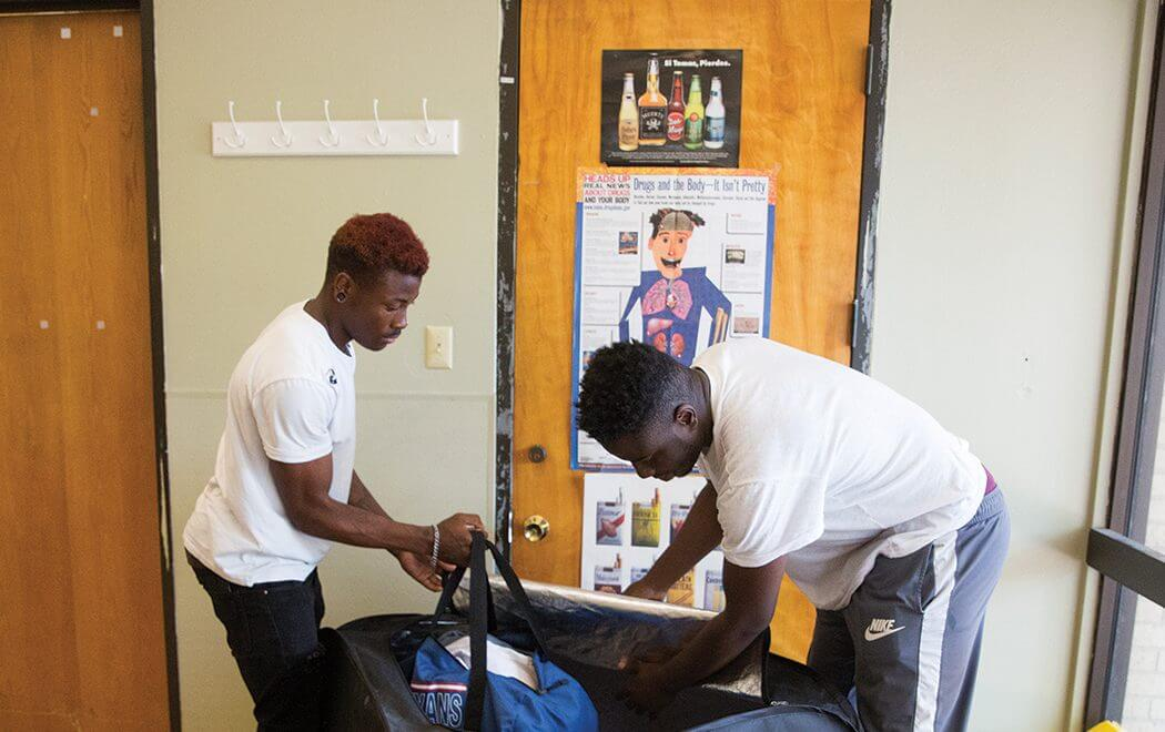 Marquis, left, and Xavior arrive at Covenant House Texas in Houston.