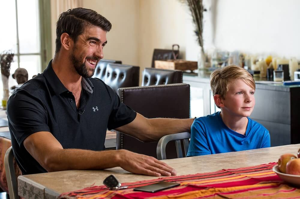 Olympic swimmer Michael Phelps appears in the film with a boy named Charlie.