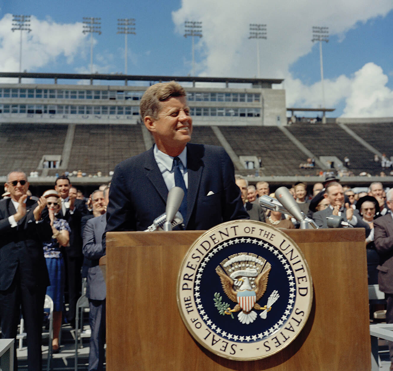 "President John F. Kennedy receives applause on Sept. 12, 1962, at Rice Stadium, where he gave his famous ""We choose to go to the moon"" speech, challenging the United States to become the world's leading space-exploring nation (Photo courtesy of Woodson Research Center, Fondren Library, Rice University)"