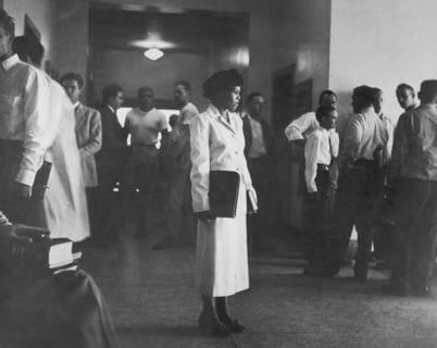 Edith Irby Jones standing alone in the hallway of the University of Arkansas Medical School, 1949. (Photo credit: National Institutes of Health)