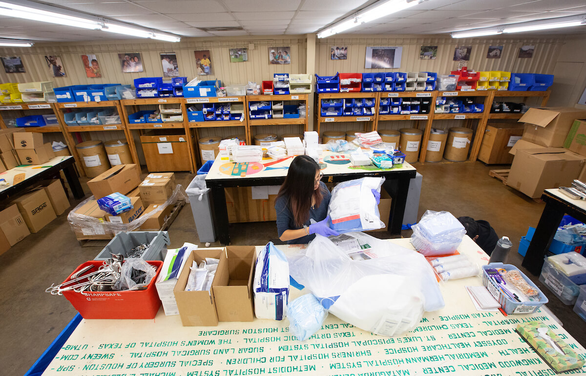 A Medical Bridges volunteer prepares medical supplies for shipment to the Bahamas.