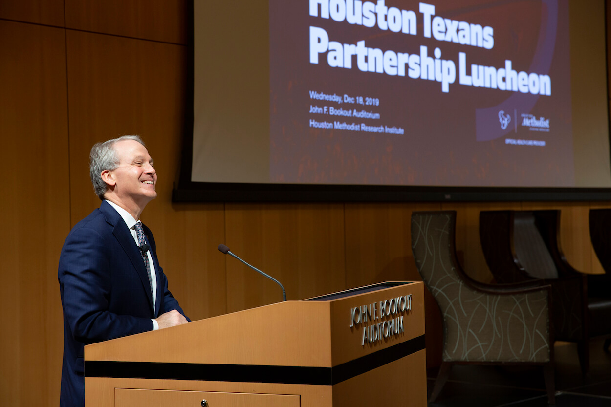 Dr. Marc Boom, president and CEO of Houston Methodist, welcomes guests to celebrate the successful partnership between the Houston Texans and Houston Methodist.