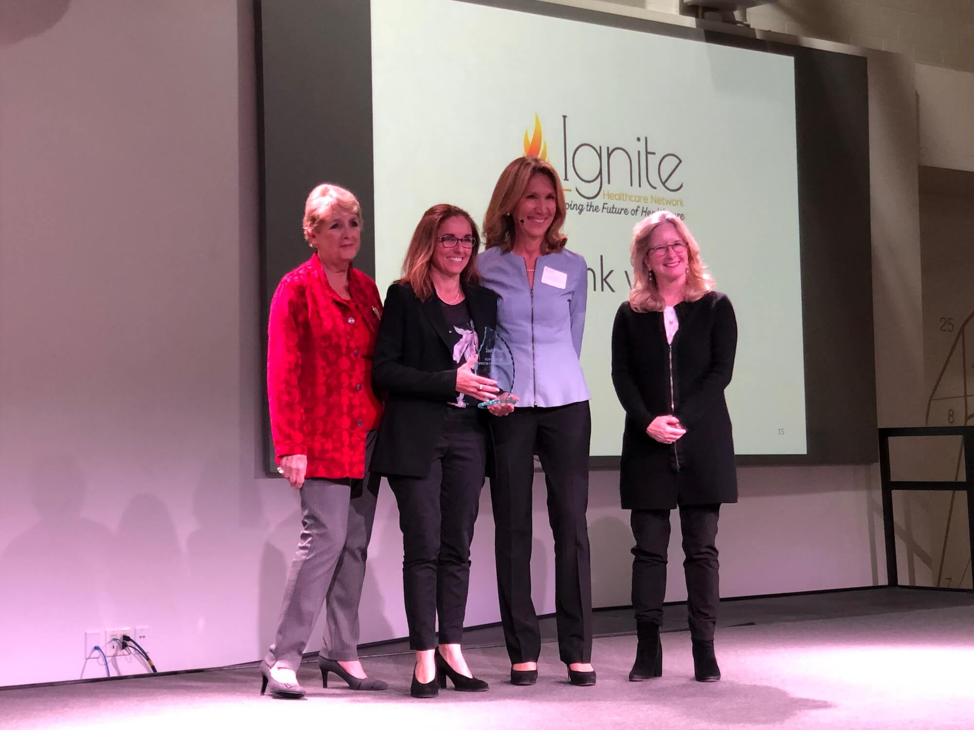 From left to right: Cheryl Stavins, Ignite board member and event co-chair; Carolyn Mee, founder and CEO of Sound Scouts and second-place winner of the Third Annual Fire Pitch Competition; Ayse McCracken, Ignite founder; and Patricia Gail Bray, Ph.D., Ignite board member and founding director of the BridgeUp Center at The Menninger Clinic.