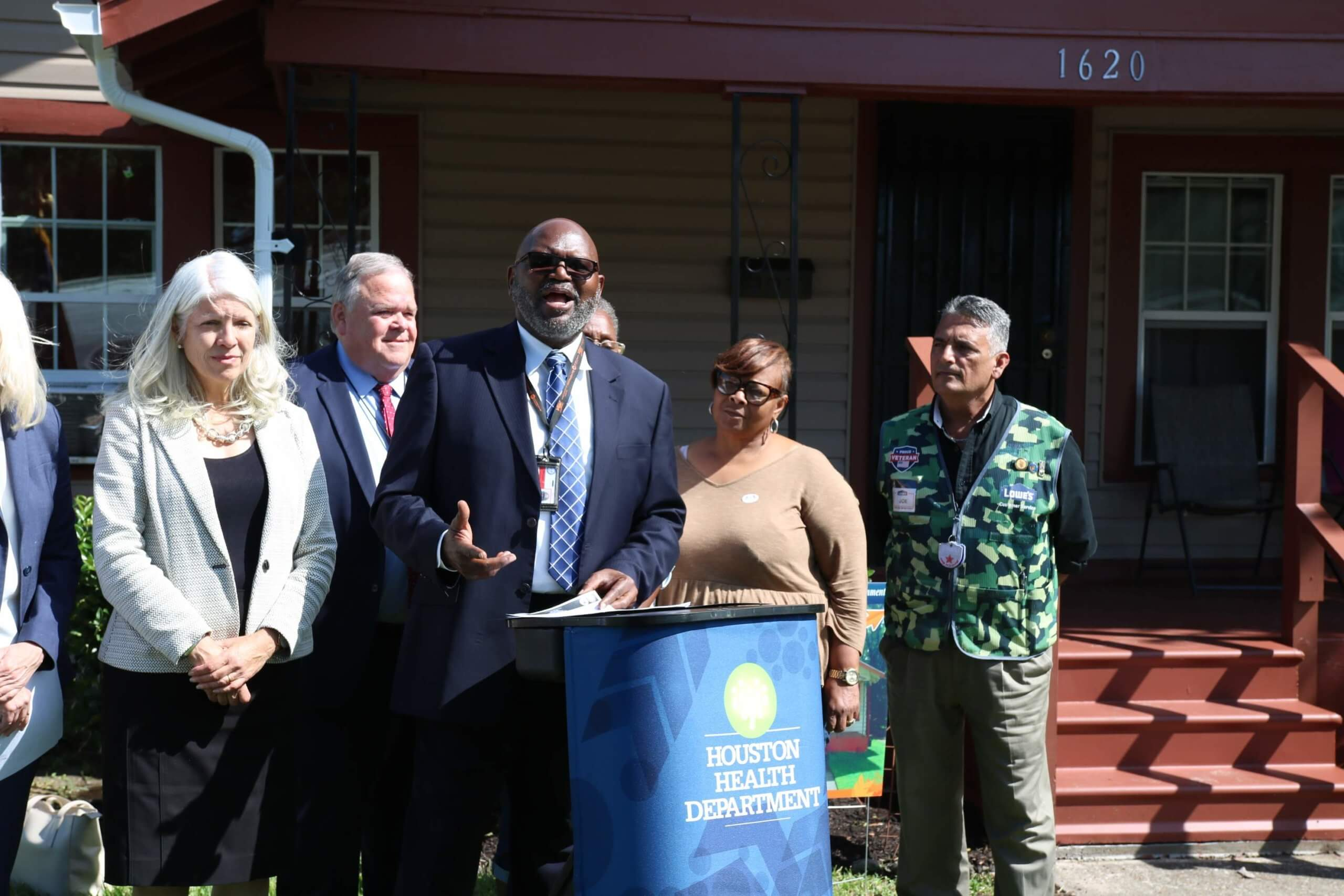 Houston Health Department Director Stephen Williams announces a $9.7 million HUD grant for lead-based paint hazard reduction to 450 homes outside a recently abated house in Fifth Ward. He is flanked by Clarissa Smith, to his immediate right, a community block captain who refers homes to the program. (Photo courtesy of Houston Health Department)