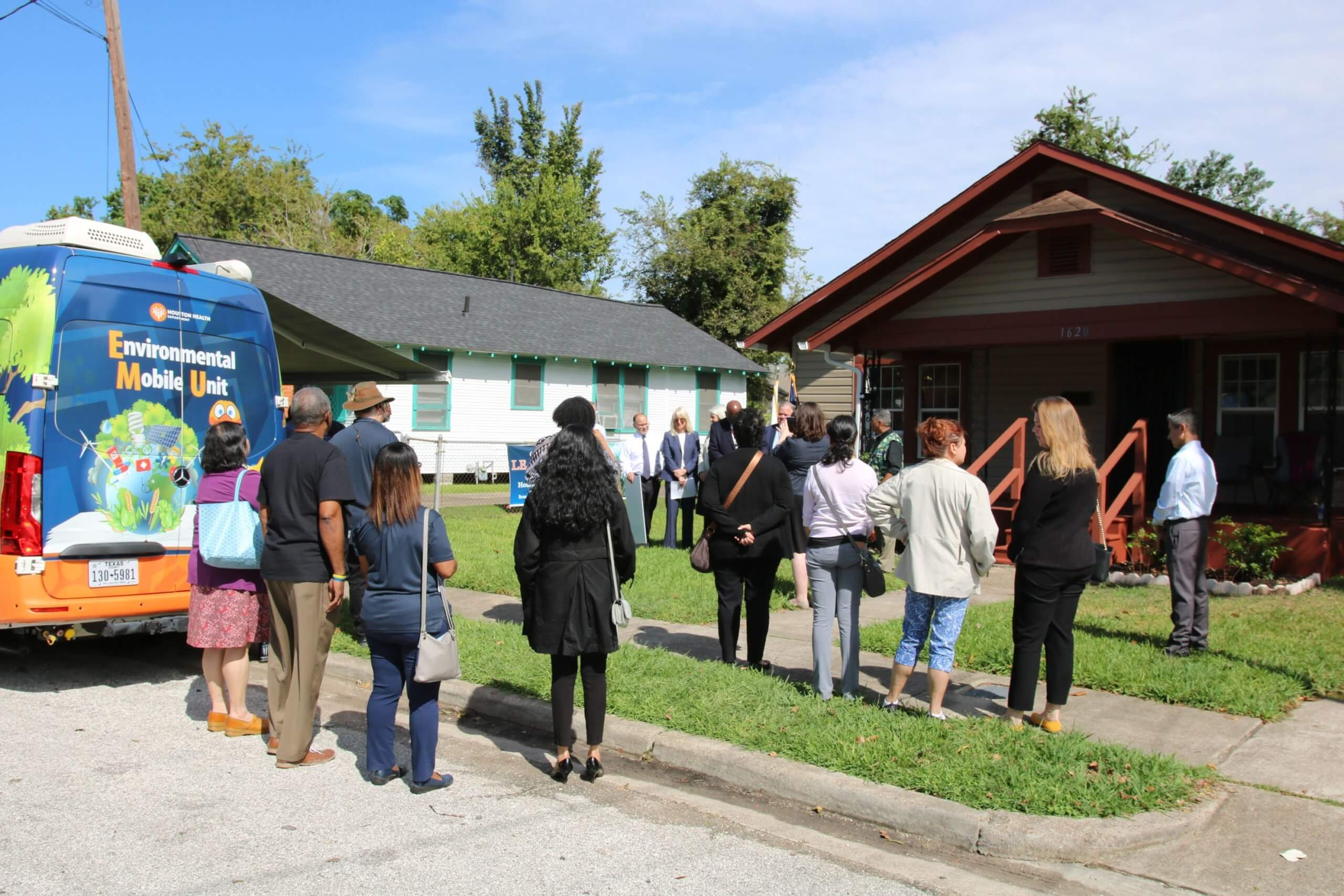 A crowd gathers outside a Fifth Ward home as officials from the Houston Health Department and the U.S. Department of Housing and Urban Development announce $9.7 million in funding to abate lead in 450 Houston homes. (Photo courtesy of Houston Health Department)