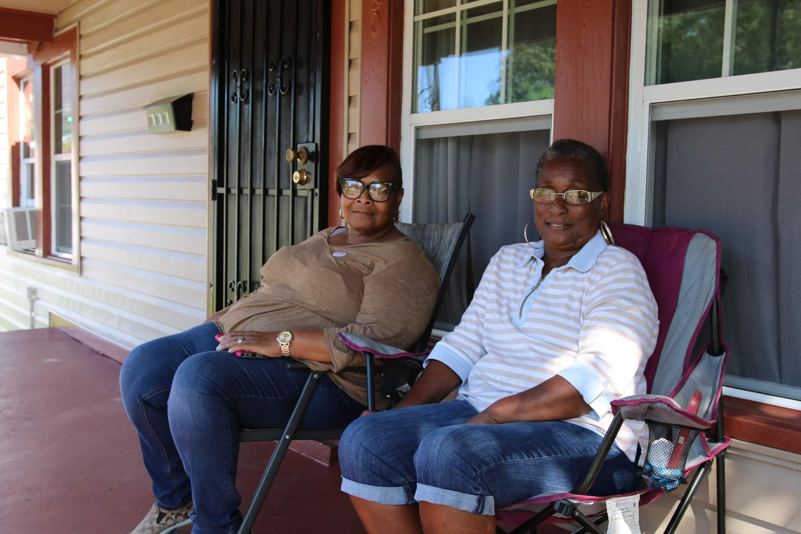 Clarissa Smith, left, a block captain who educates residents and refers homes for lead abatement, with Nyoka Wright, a homeowner who had lead removed from her house. Wright is a great-grandmother who babysits two grandchildren after school and all summer. (Photo courtesy of Houston Health Department)