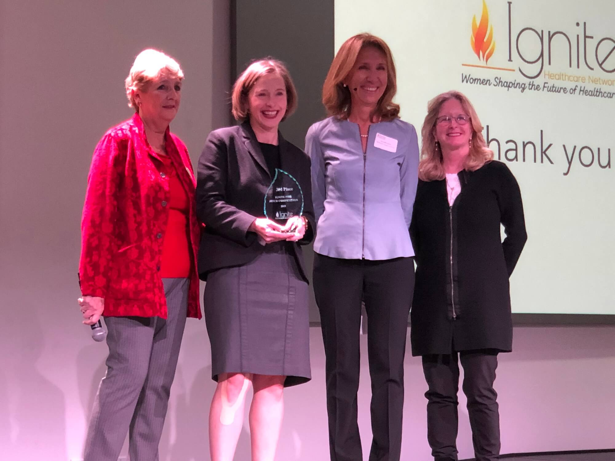 From left to right: Cheryl Stavins, Ignite board member and event co-chair;  Mylea Charvet, Ph.D., founder and CEO of Savonix and the third-place winner of the Third Annual Fire Pitch Competition; Ayse McCracken, Ignite founder; and Patricia Gail Bray, Ph.D., Ignite board member and founding director of the BridgeUp Center at The Menninger Clinic.