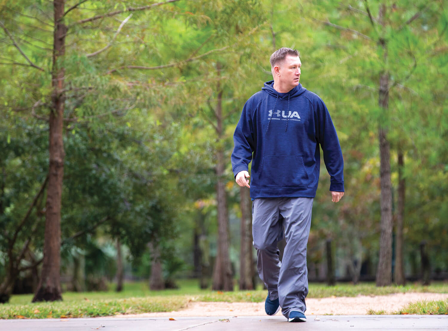 J Y Reynolds walks through Hermann Park.