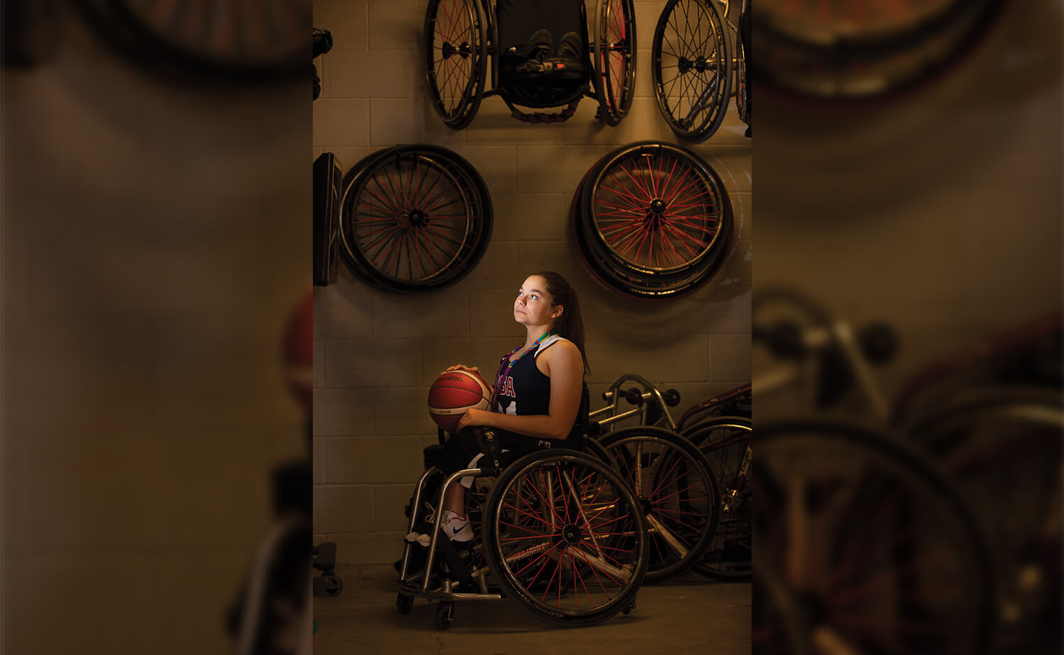 Kaitlyn Eaton poses with the team's wheelchairs.