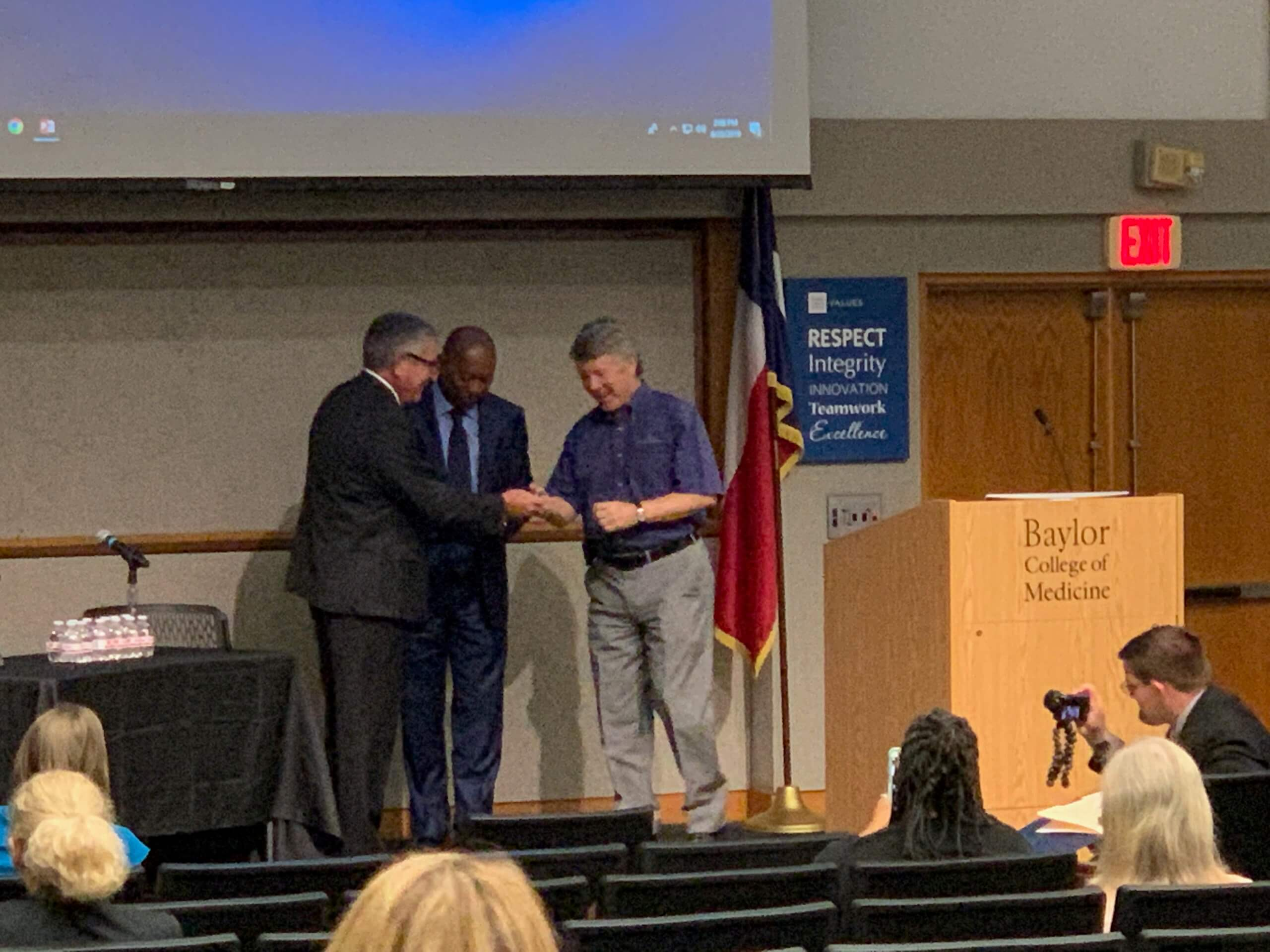 Baylor College of Medicine President Paul Klotman, M.D., recognized Mayor Sylvester Turner, center, and former Harris County Judge Ed Emmett, right, for their leadership before, during and after Hurricane Harvey.
