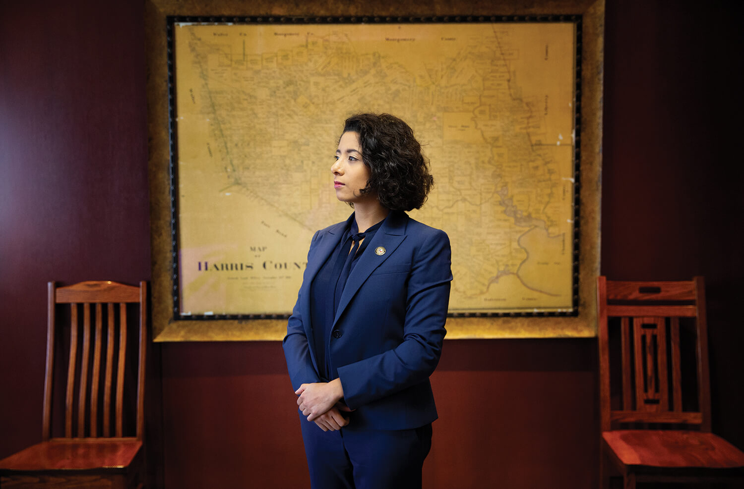 Harris County Judge Lina Hidalgo poses in her office before a historic map of the county she leads. Photo by Cody Duty.