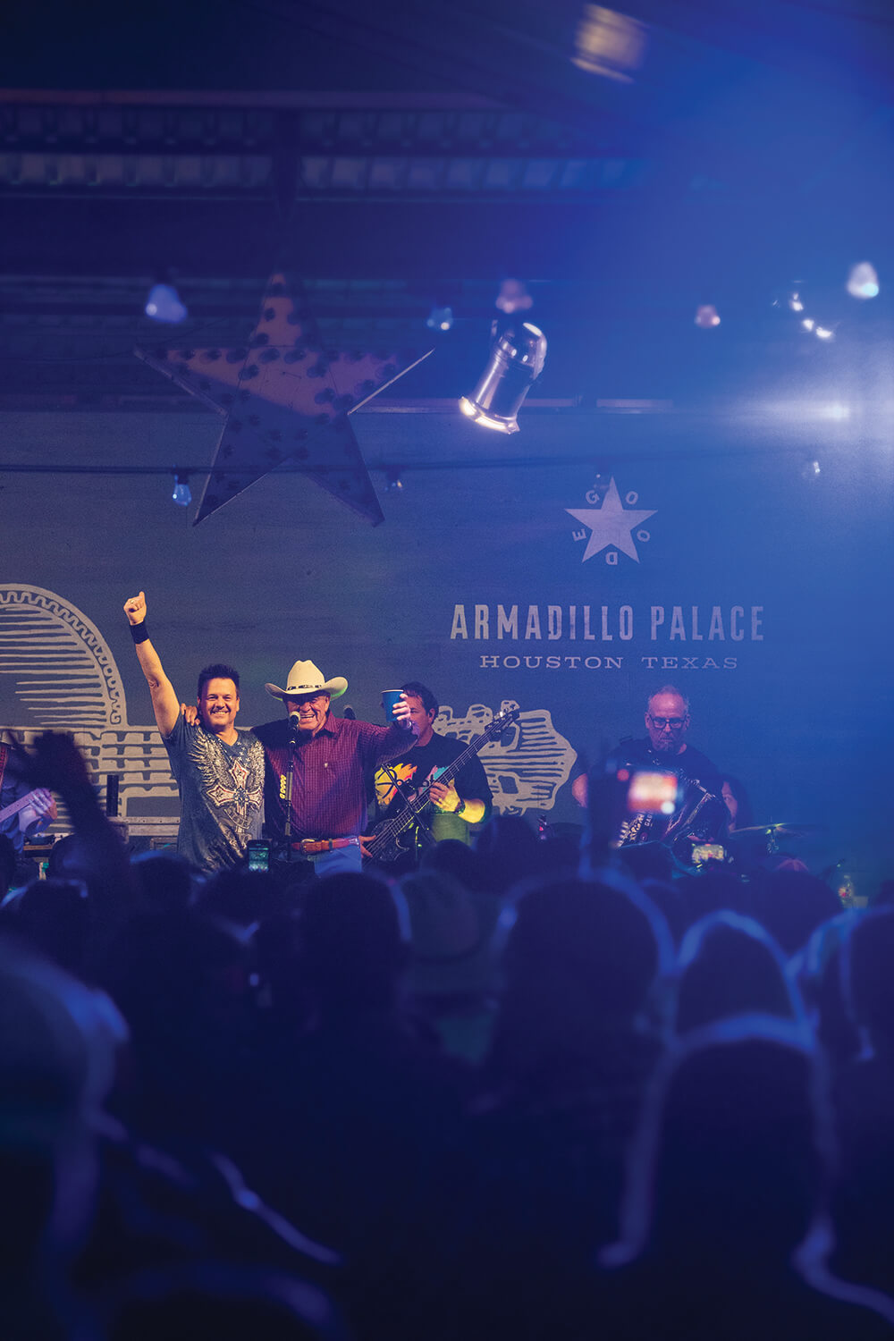 Roger Creager (left) and his father, Bill Creager, perform together at the Armadillo Palace in Houston, Texas on Dec. 28, 2019.